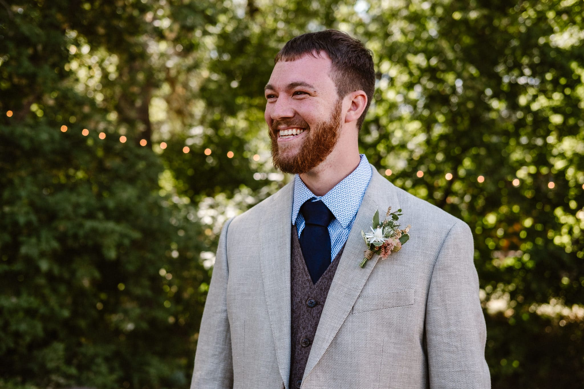 Lyons Farmette wedding photographer, Colorado intimate wedding photographer, groom portrait, groom wearing tan jacket and dark vest