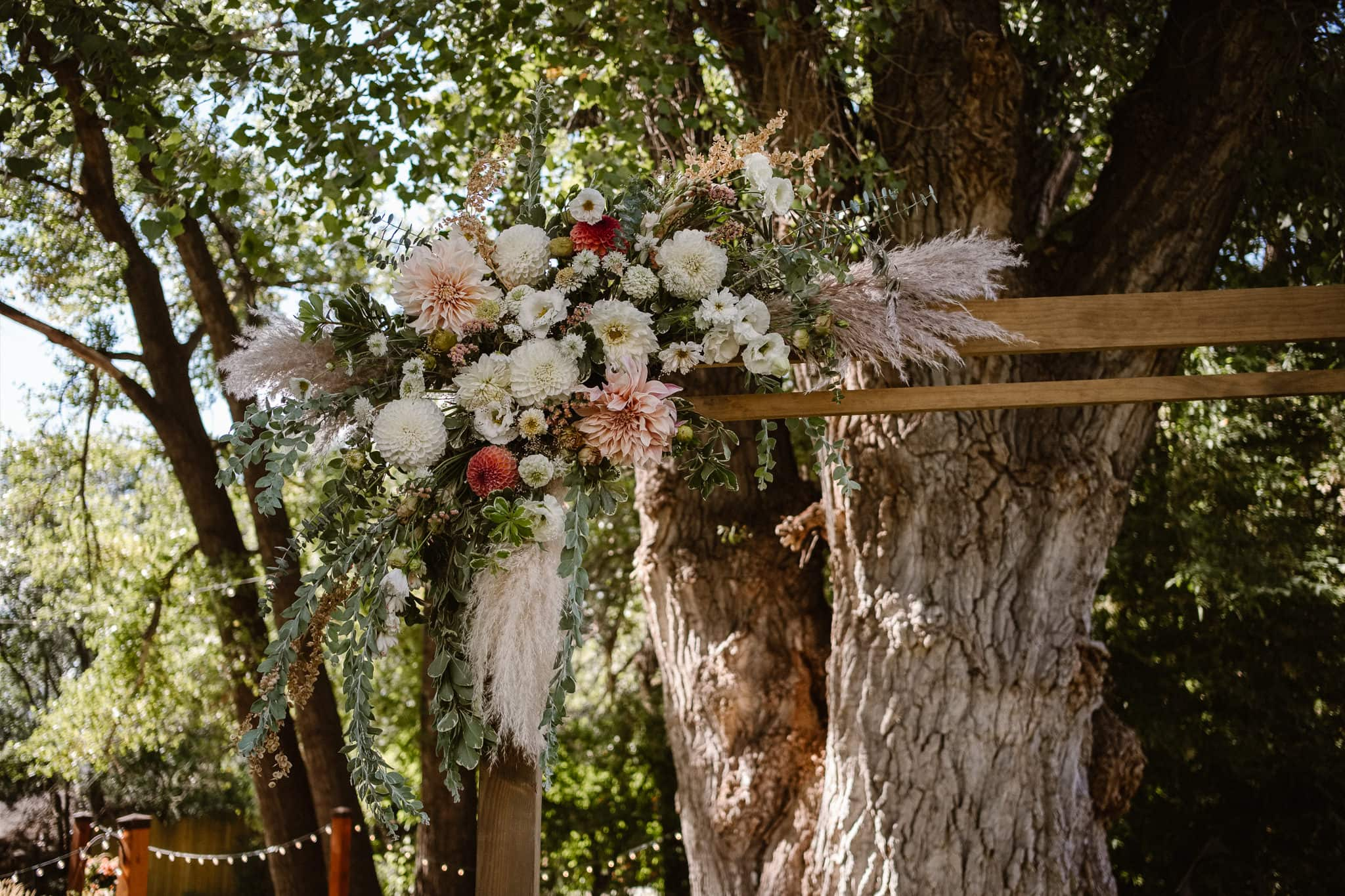 Lyons Farmette wedding photographer, Colorado intimate wedding photographer, outdoor ceremony site, Colorado wedding venue, wood ceremony arch with floral arrangement