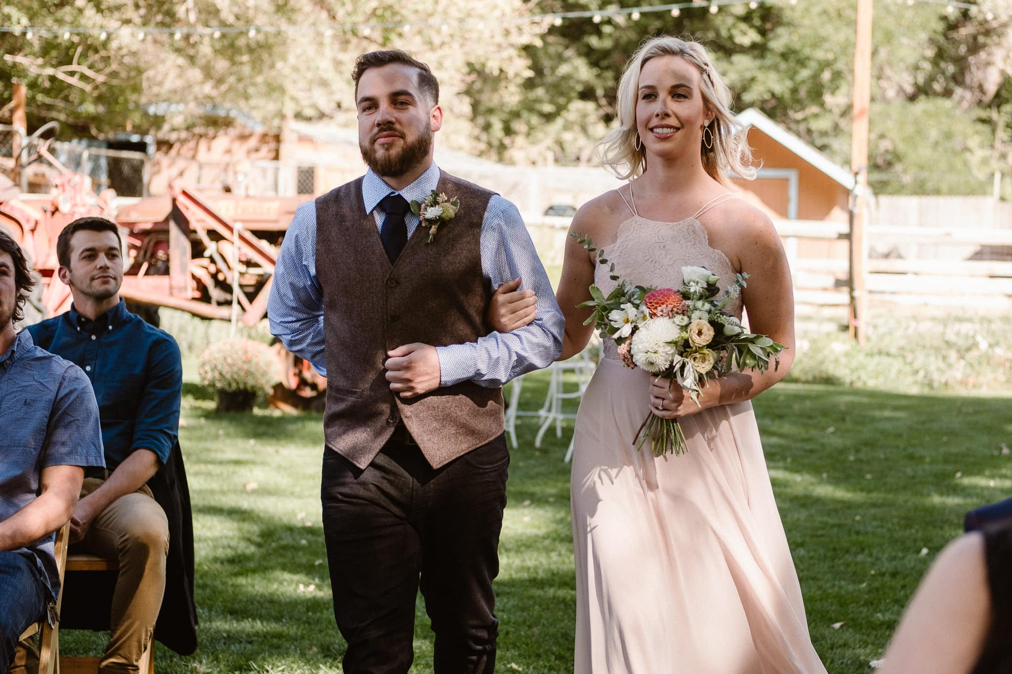 Lyons Farmette wedding photographer, Colorado intimate wedding photographer, wedding ceremony, bridesmaid and groomsman walking down aisle