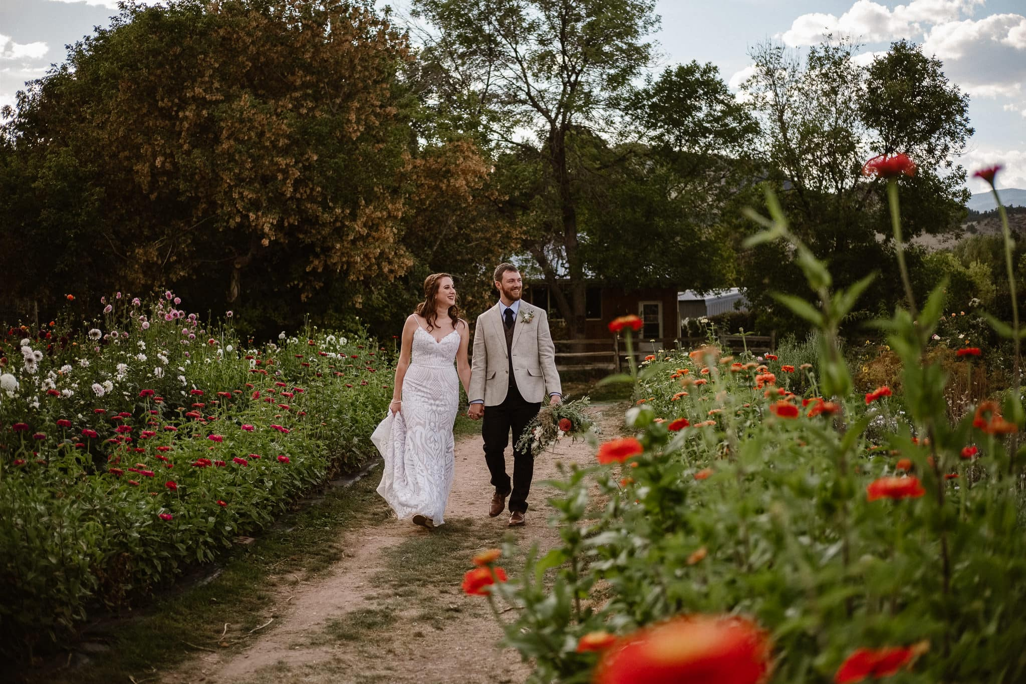 Lyons Farmette wedding photographer, Colorado intimate wedding photographer, bride and groom photos walking through flower garden