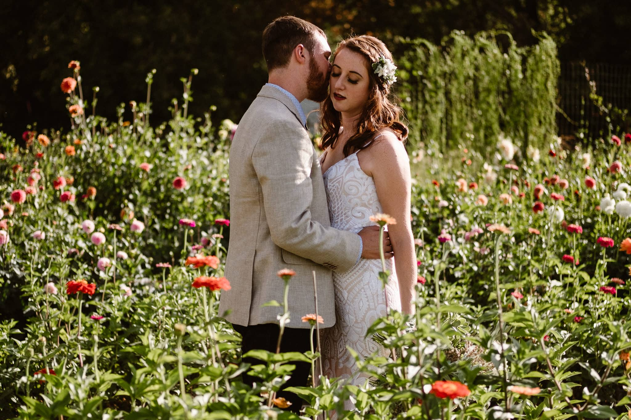 Lyons Farmette wedding photographer, Colorado intimate wedding photographer, bride and groom photos in flower garden