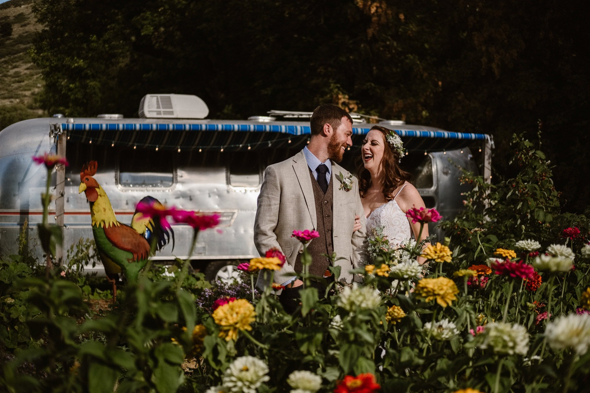Lyons Farmette wedding photographer, Colorado intimate wedding photographer, bride and groom photos in front of airstream