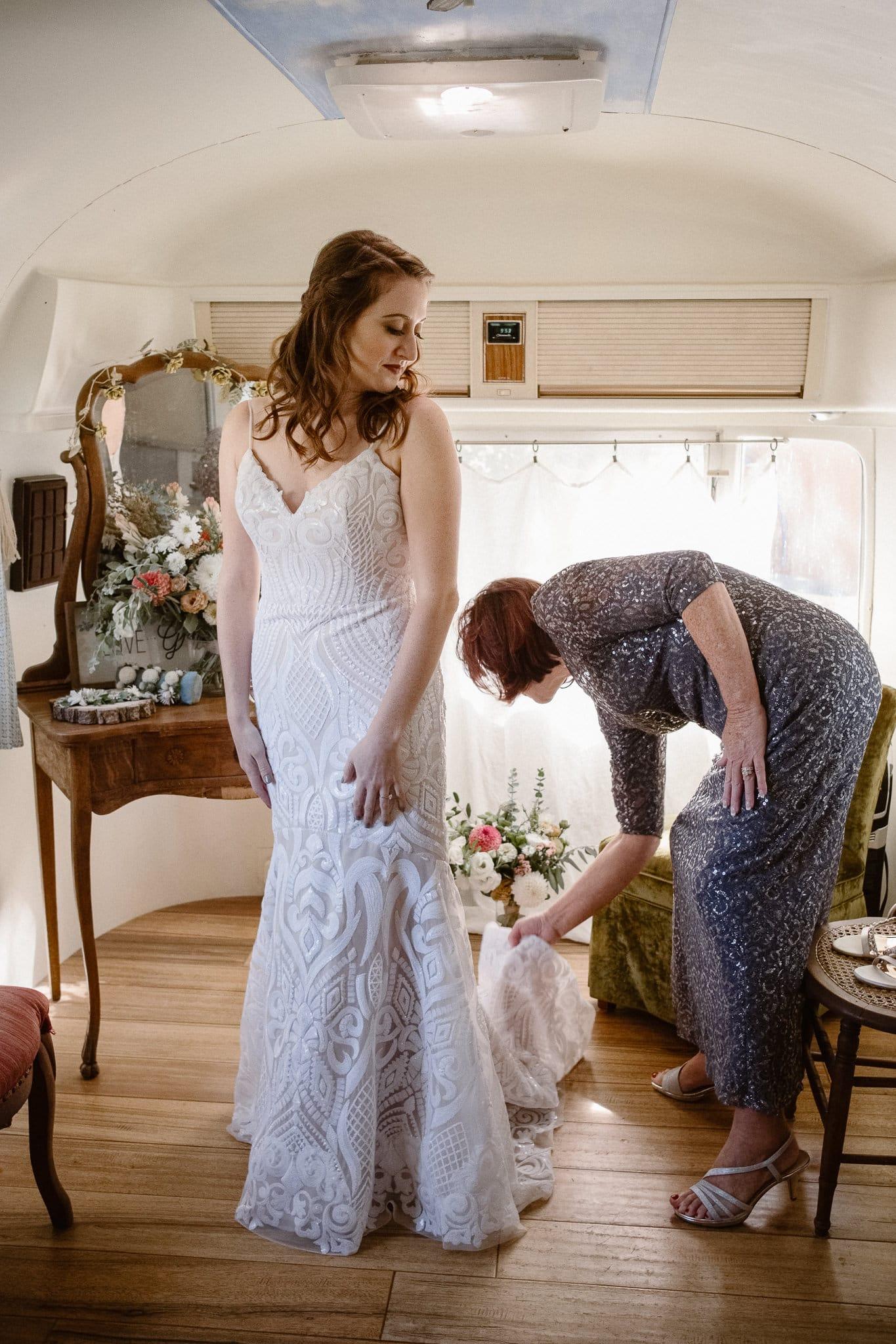 Lyons Farmette wedding photographer, Colorado intimate wedding photographer, bride getting ready in airstream, rue de seine wedding dress
