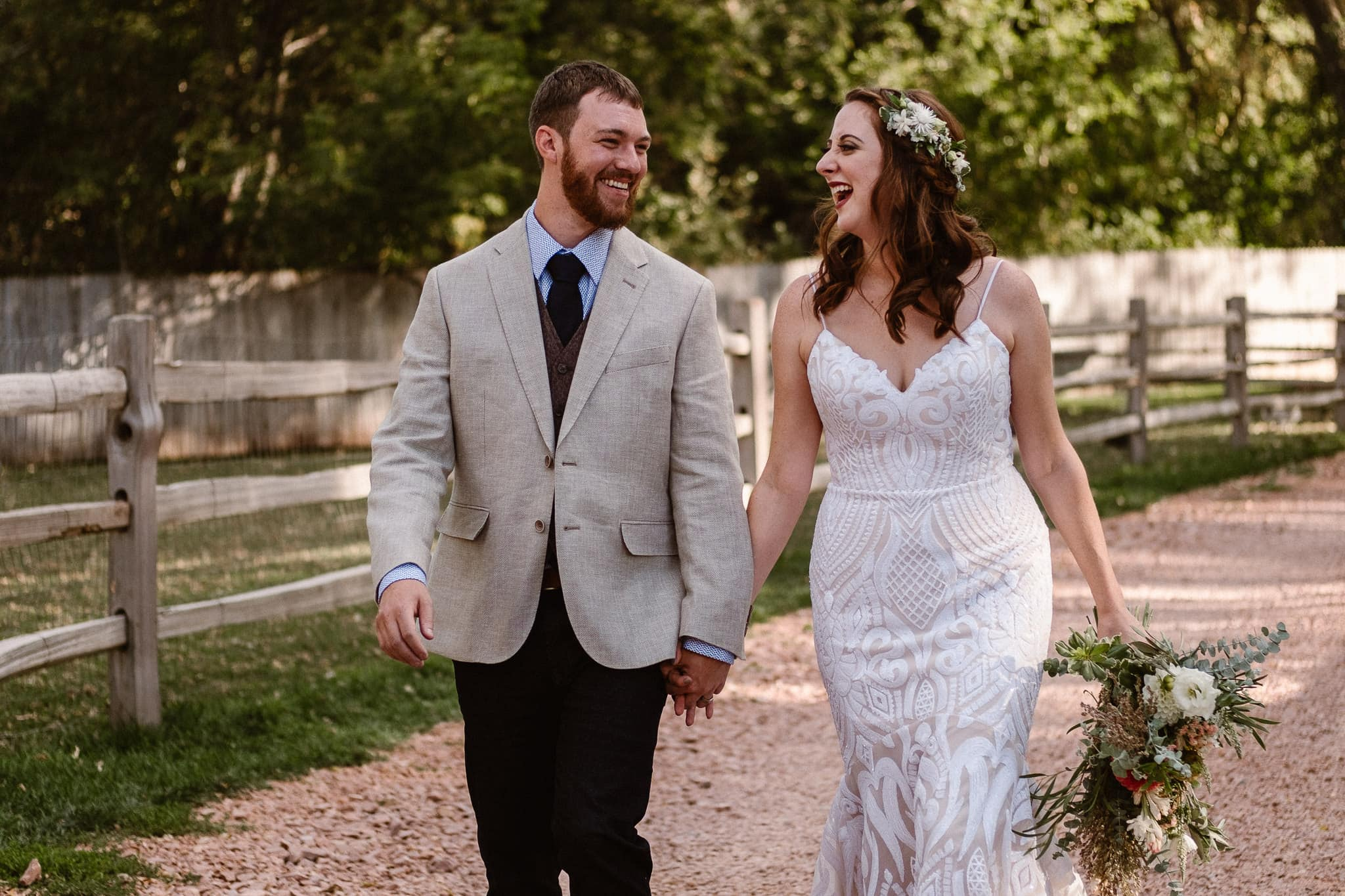 Lyons Farmette wedding photographer, Colorado intimate wedding photographer, bride and groom walking and laughing