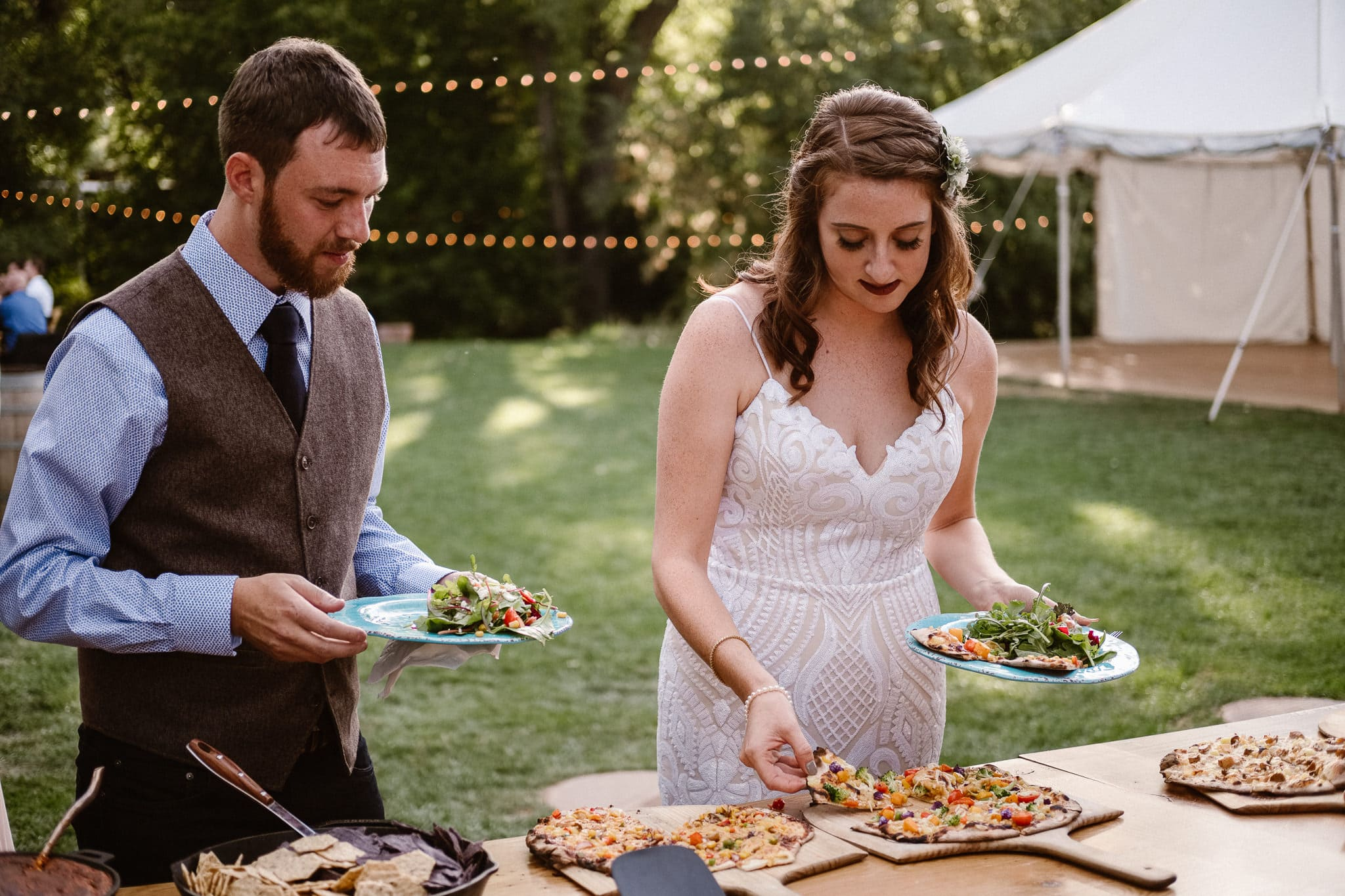 Lyons Farmette wedding photographer, Colorado intimate wedding photographer, bride and groom getting pizza, Mountain Crust, pizza food truck