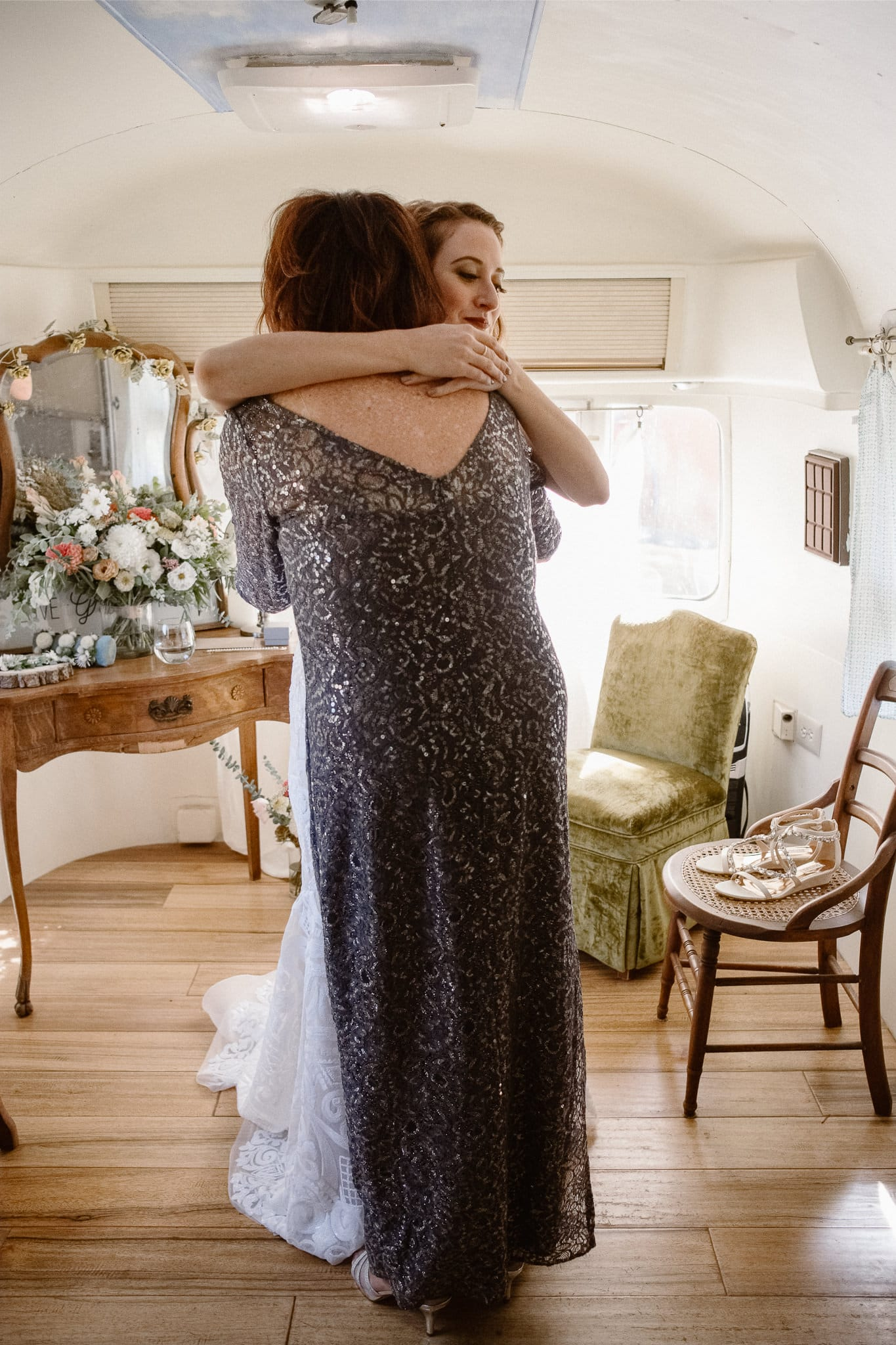 Lyons Farmette wedding photographer, Colorado intimate wedding photographer, bride getting ready in airstream, rue de seine wedding dress, bride hugging her mom