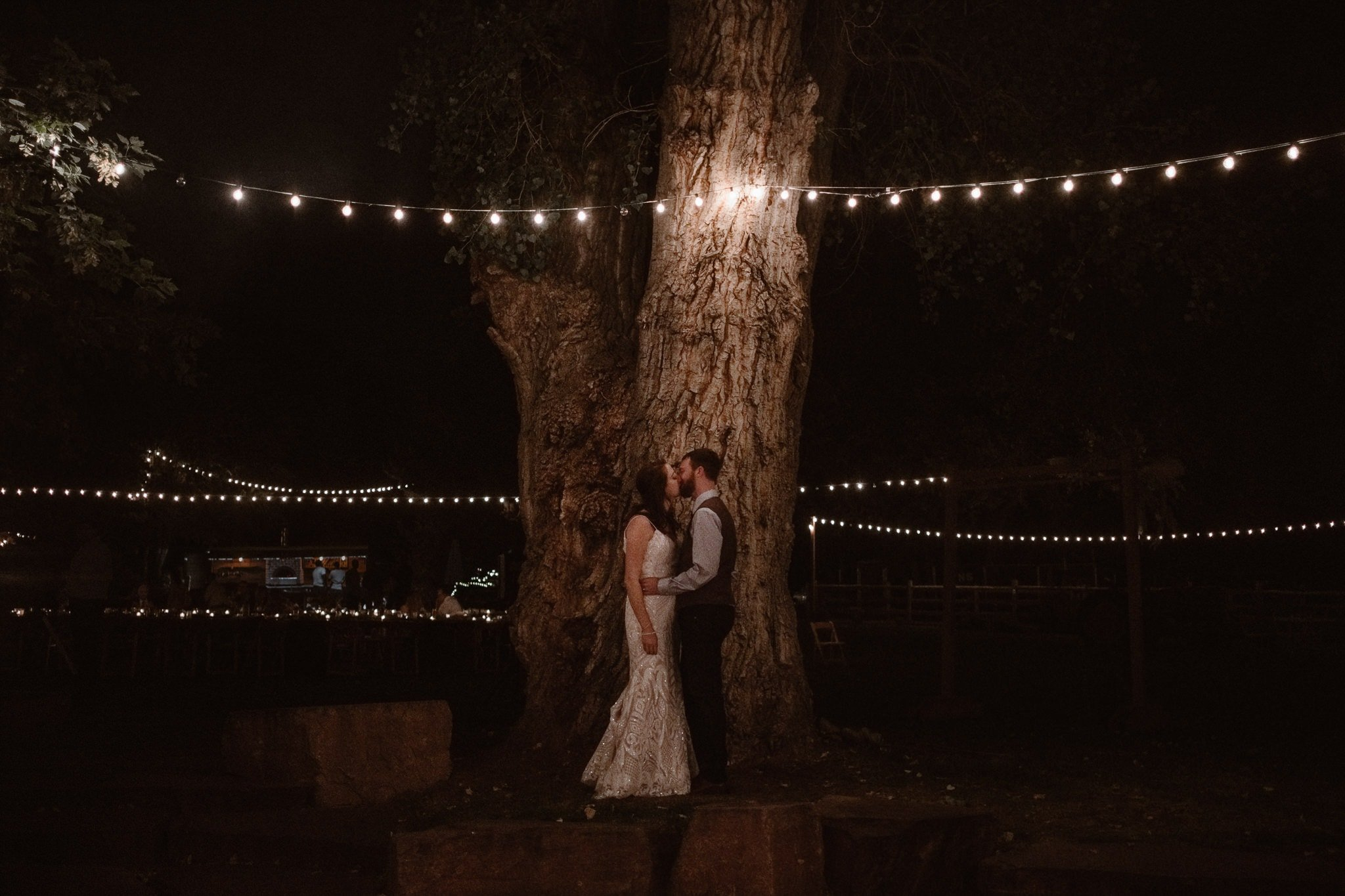 Lyons Farmette wedding photographer, Colorado intimate wedding photographer, bride and groom at night under string lights