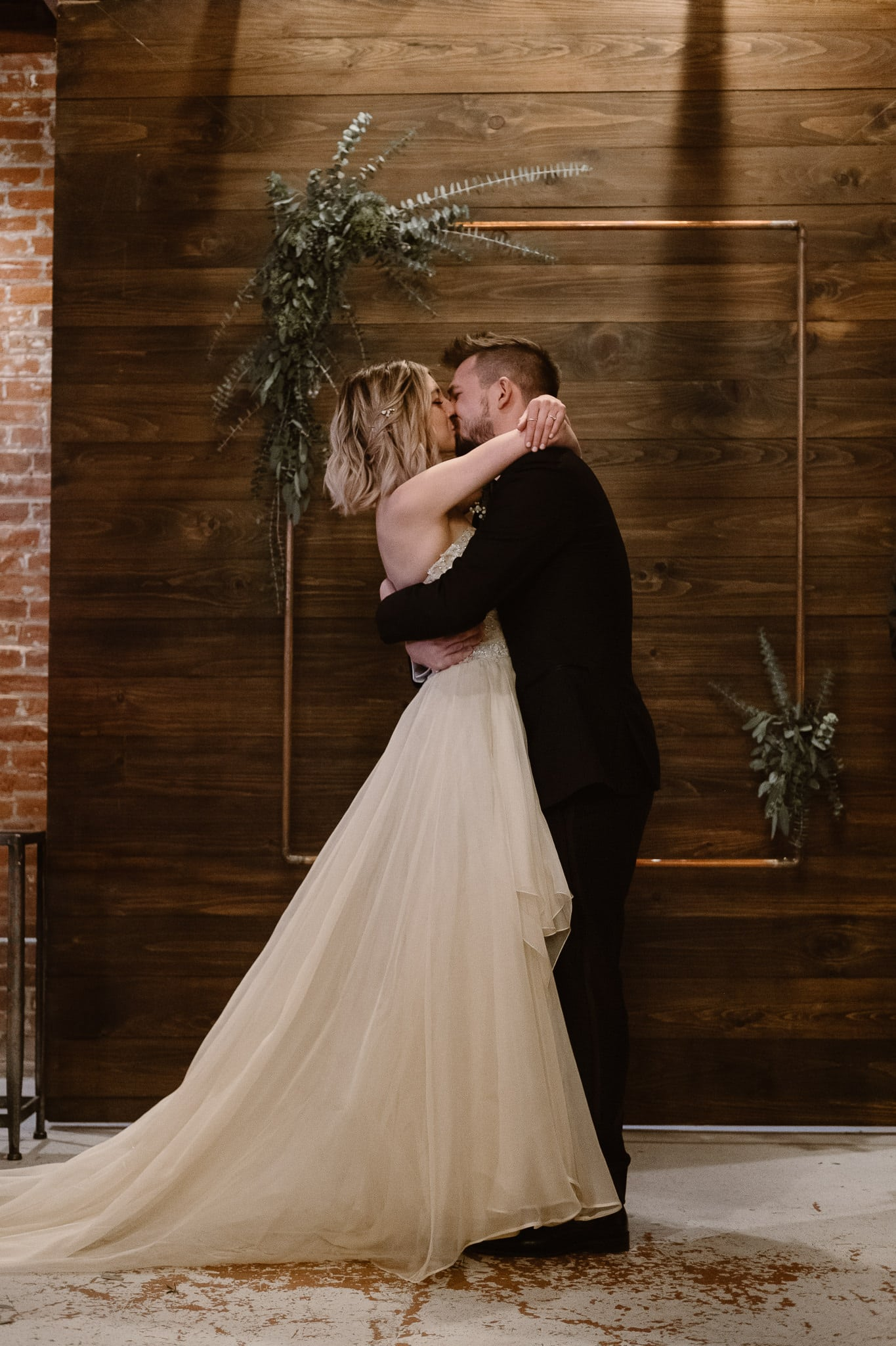 St Vrain Wedding Photographer | Longmont Wedding Photographer | Colorado Winter Wedding Photographer, Colorado industrial chic wedding ceremony, first kiss