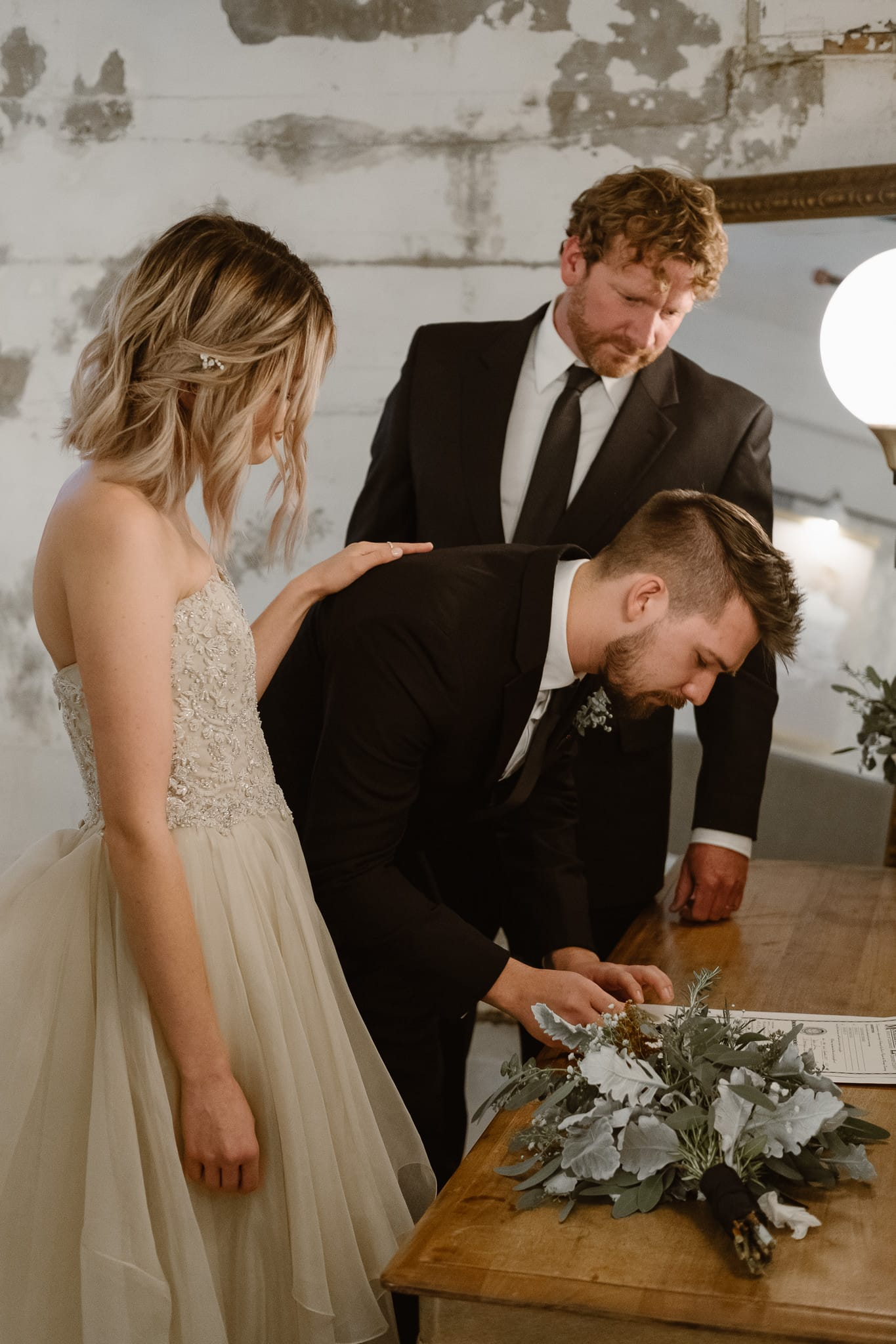 St Vrain Wedding Photographer | Longmont Wedding Photographer | Colorado Winter Wedding Photographer, Colorado industrial chic wedding ceremony, bride and groom signing marriage license