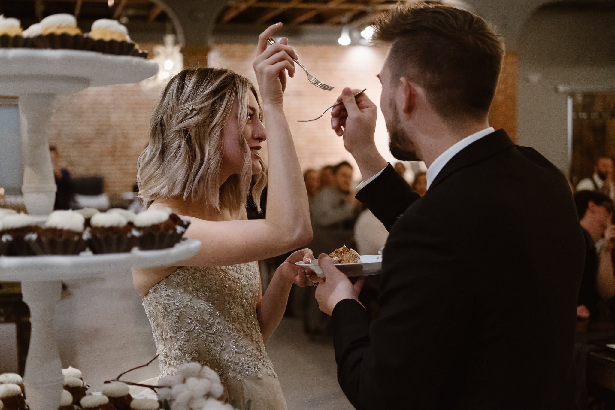 St Vrain Wedding Photographer | Longmont Wedding Photographer | Colorado Winter Wedding Photographer, Colorado industrial chic wedding ceremony, bride and groom cutting bundt cake