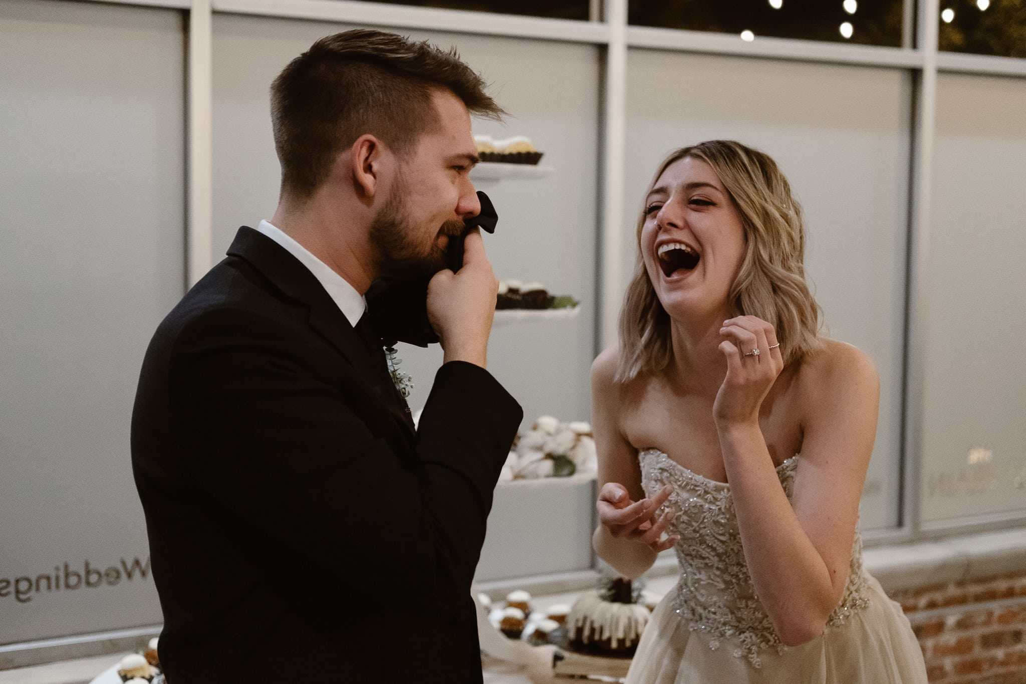 St Vrain Wedding Photographer | Longmont Wedding Photographer | Colorado Winter Wedding Photographer, Colorado industrial chic wedding ceremony, bride and groom cutting cake, smashing cake in groom's face