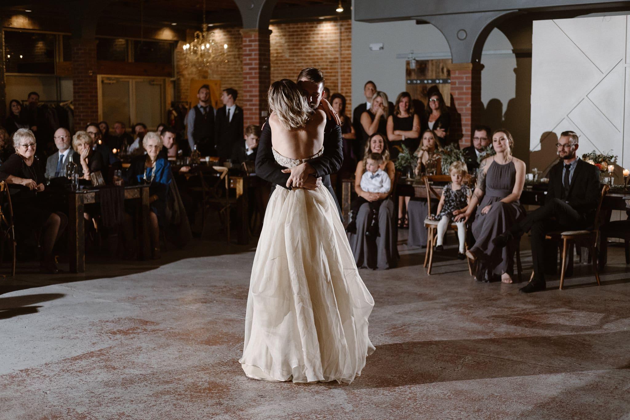 St Vrain Wedding Photographer | Longmont Wedding Photographer | Colorado Winter Wedding Photographer, Colorado industrial chic wedding ceremony, bride and groom first dance, off camera flash photography reception lighting
