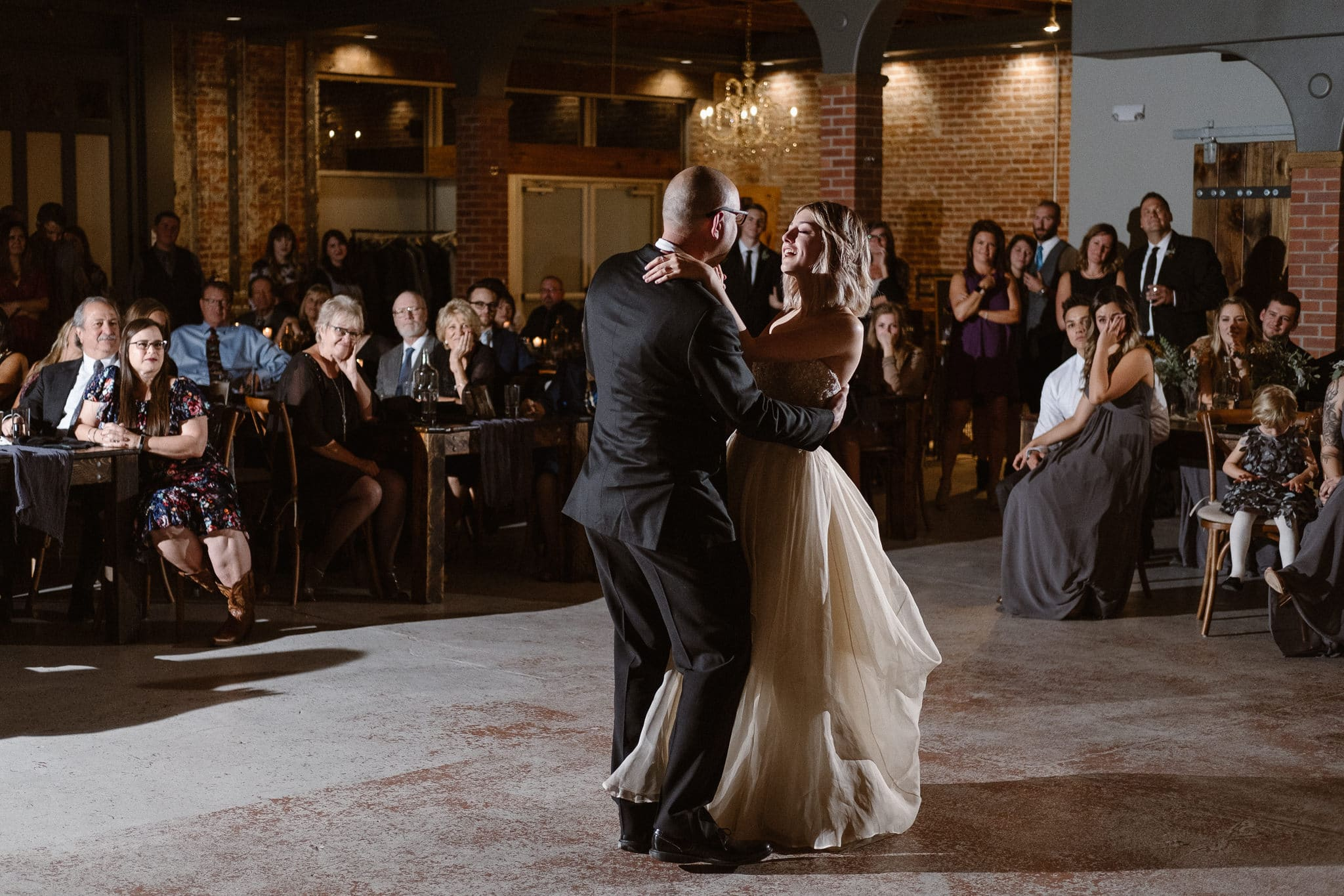 St Vrain Wedding Photographer | Longmont Wedding Photographer | Colorado Winter Wedding Photographer, Colorado industrial chic wedding ceremony, bride and father dancing, off camera flash photography reception lighting