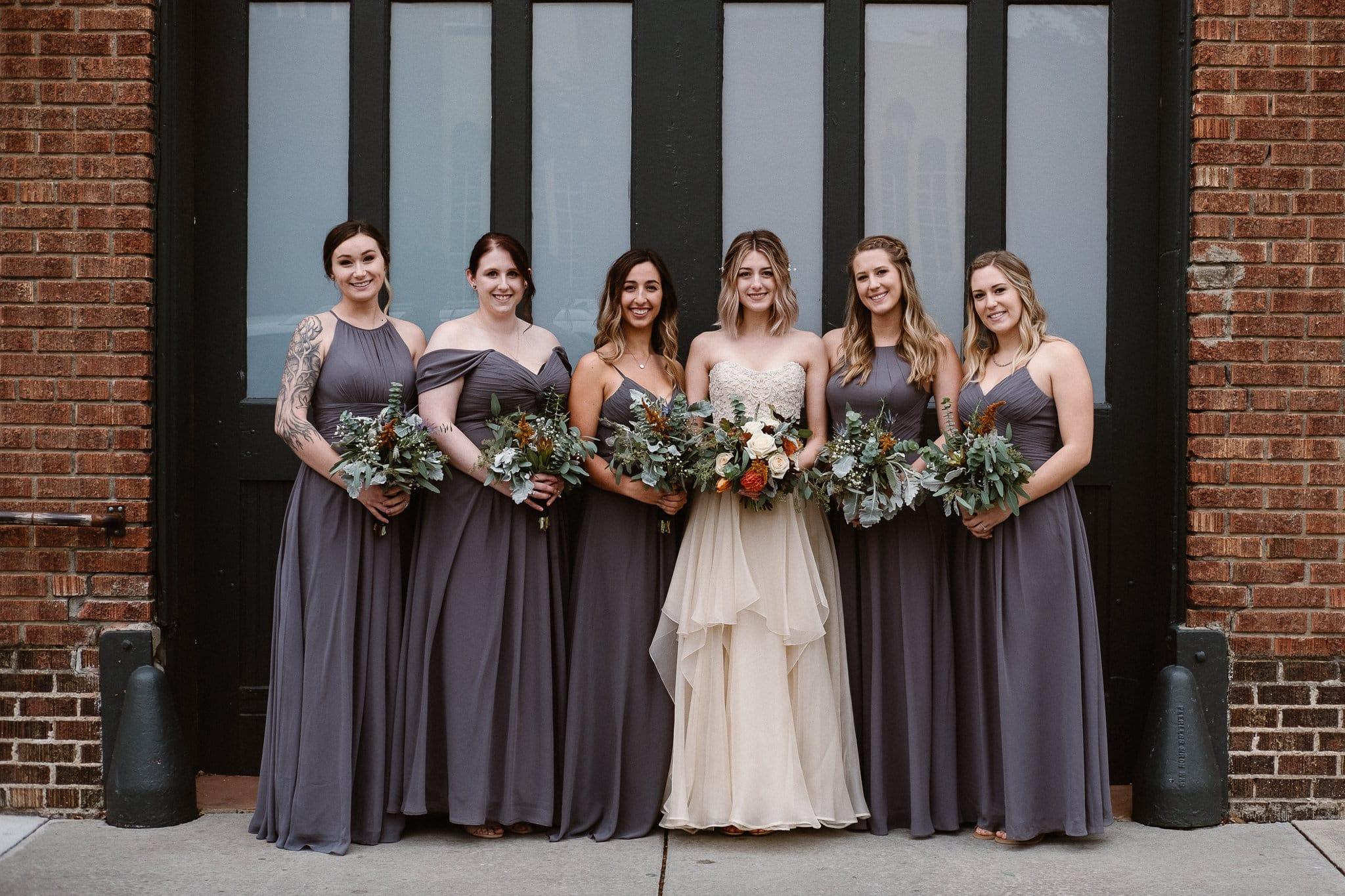 St Vrain Wedding Photographer   Longmont Wedding Photographer   Colorado Winter Wedding Photographer, Colorado industrial chic wedding, bride with bridesmaids, Marchesa wedding dress, gray bridesmaid dresses