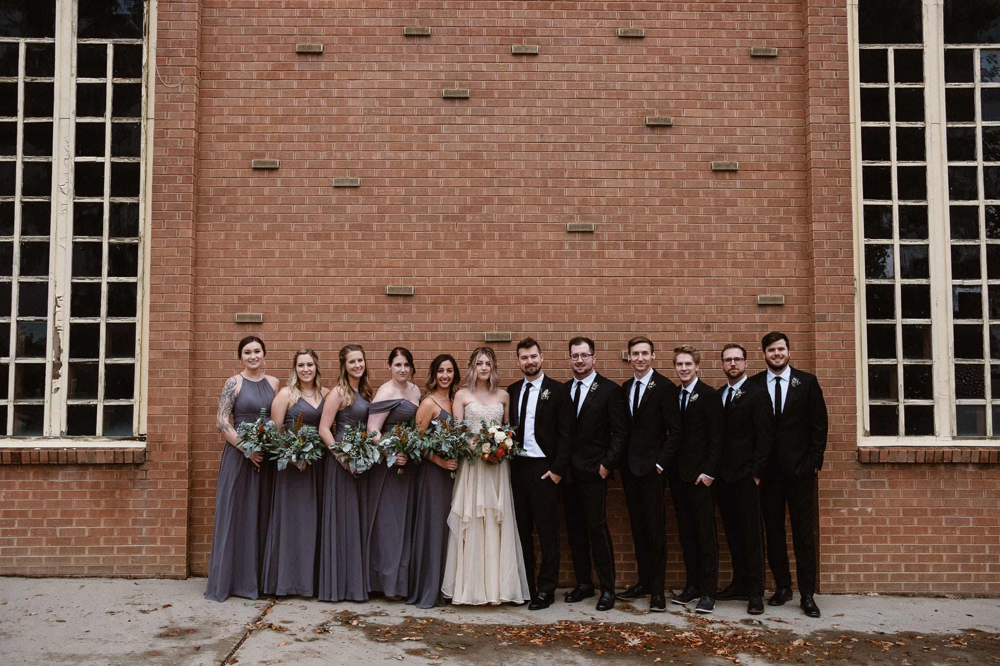 St Vrain Wedding Photographer | Longmont Wedding Photographer | Colorado Winter Wedding Photographer, Colorado industrial chic wedding, bride and groom with wedding party, dark gray bridesmaid dresses, black suits and black skinny ties