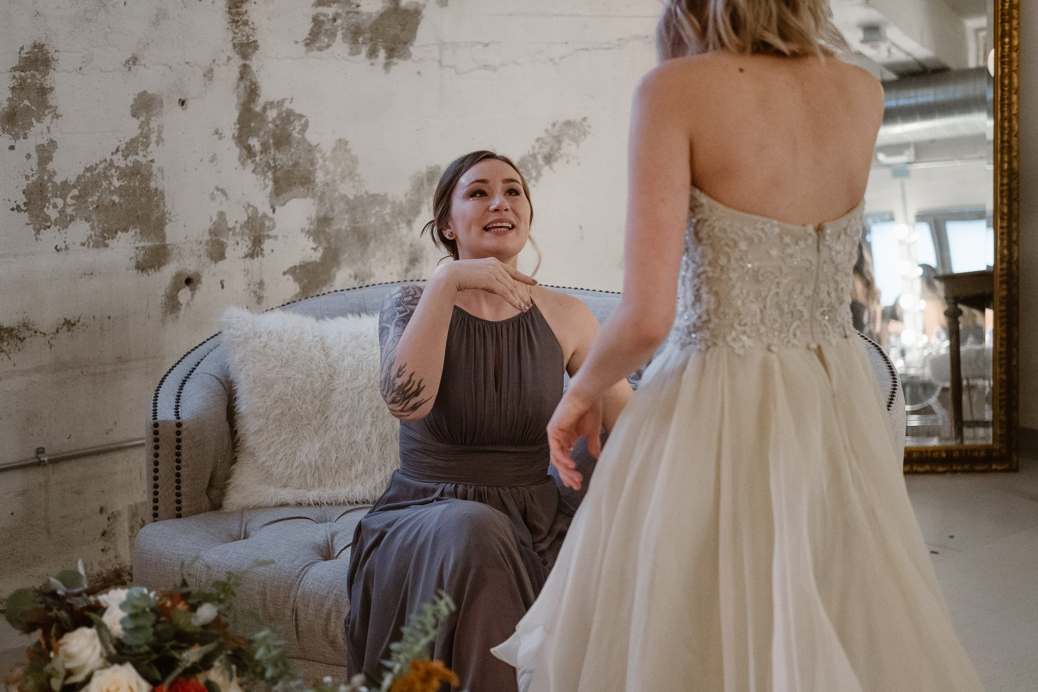 St Vrain Wedding Photographer | Longmont Wedding Photographer | Colorado Winter Wedding Photographer, Colorado industrial chic wedding, bride and bridesmaid crying