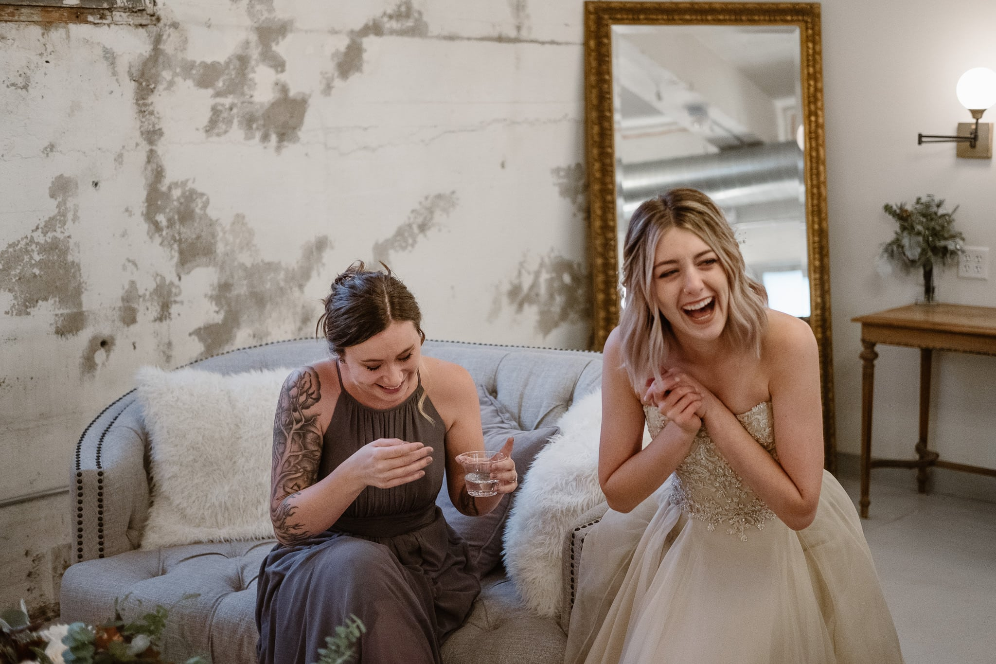St Vrain Wedding Photographer | Longmont Wedding Photographer | Colorado Winter Wedding Photographer, Colorado industrial chic wedding, bride and bridesmaid crying and laughing