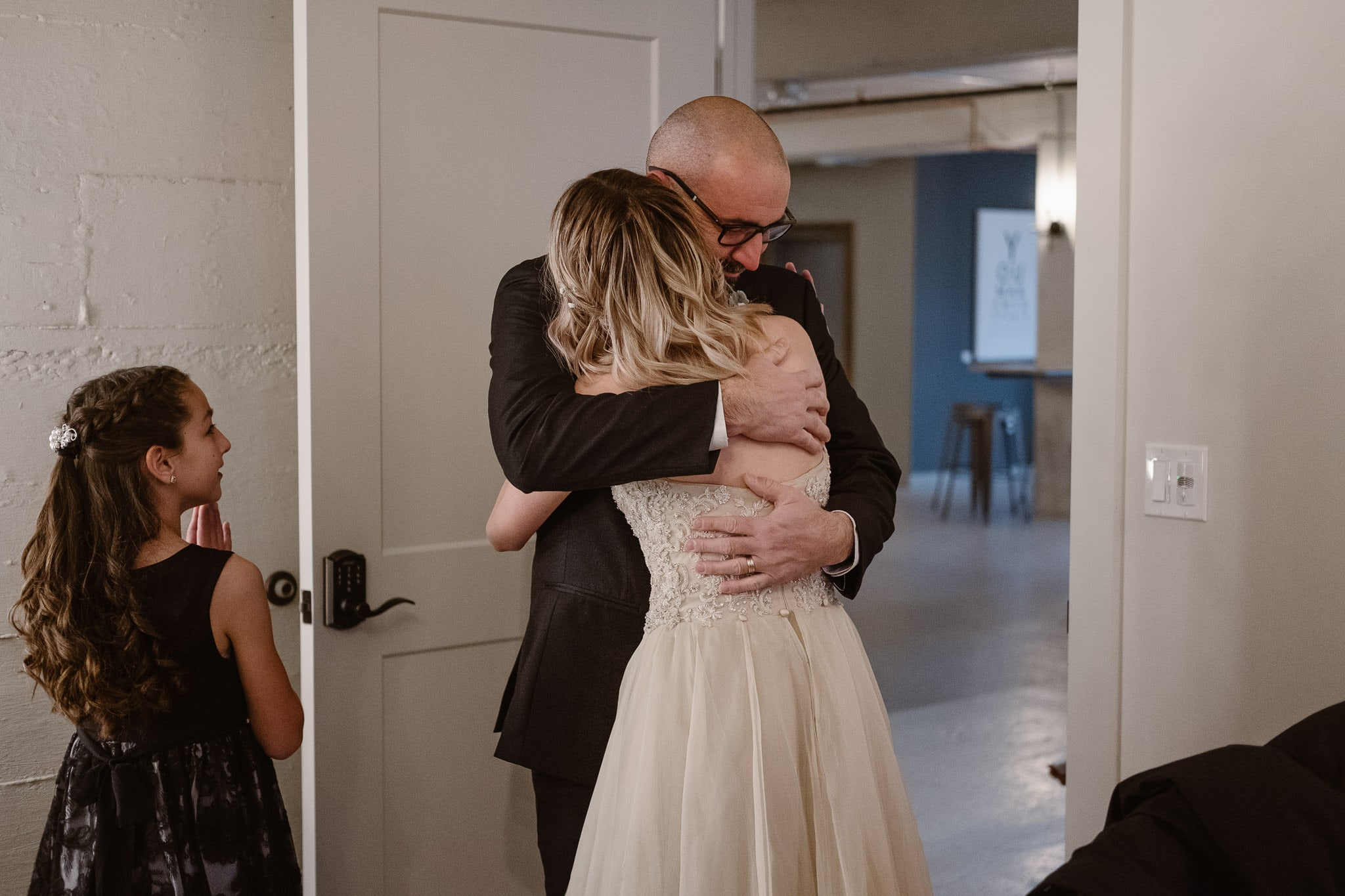St Vrain Wedding Photographer | Longmont Wedding Photographer | Colorado Winter Wedding Photographer, Colorado industrial chic wedding, bride and her father hugging