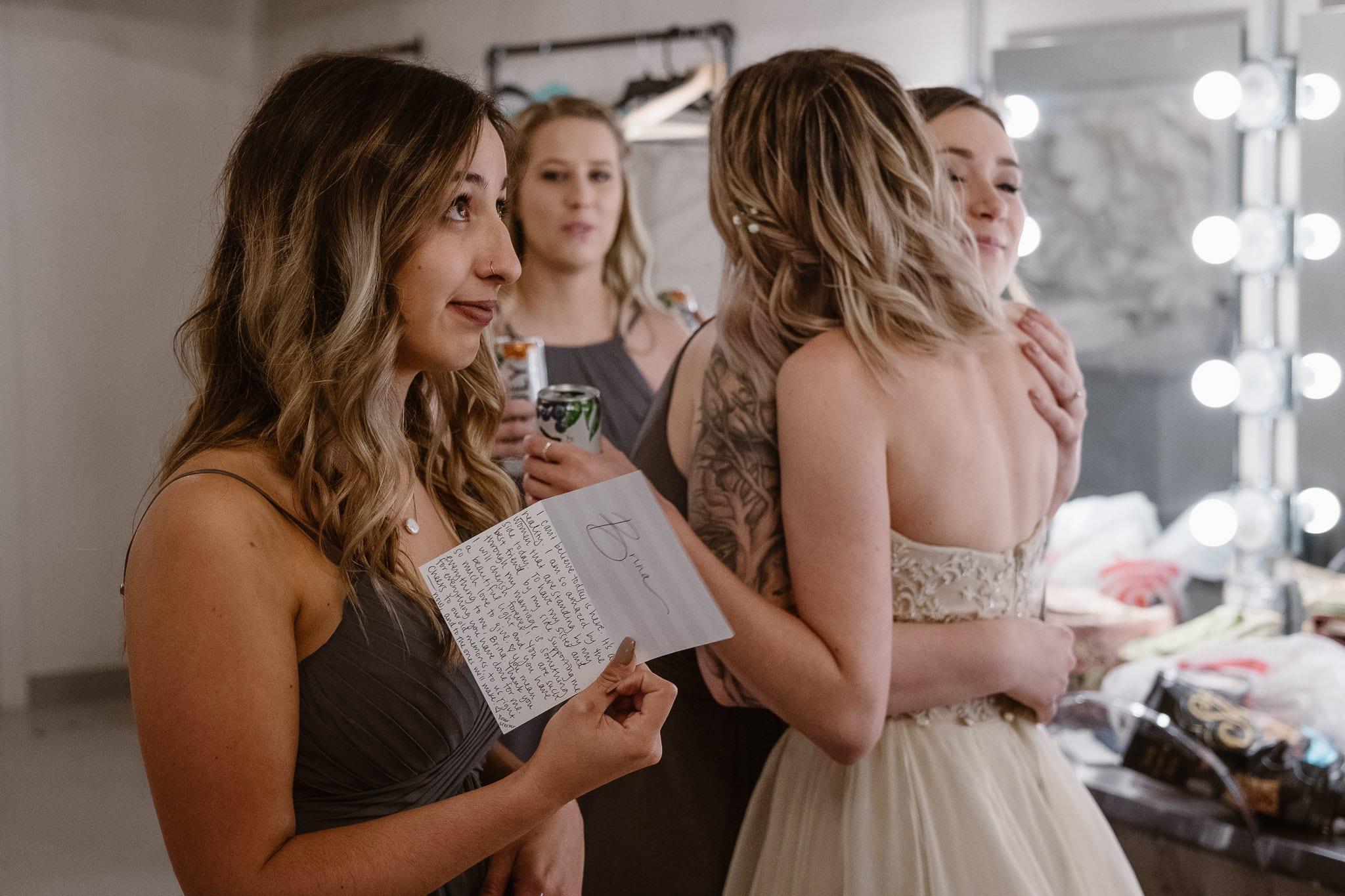 St Vrain Wedding Photographer | Longmont Wedding Photographer | Colorado Winter Wedding Photographer, Colorado industrial chic wedding, bride and bridesmaids crying