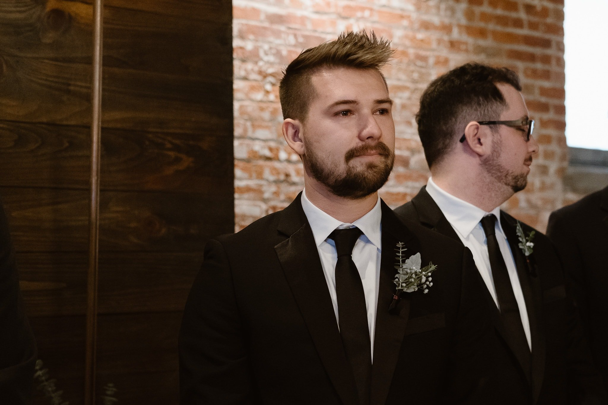 St Vrain Wedding Photographer | Longmont Wedding Photographer | Colorado Winter Wedding Photographer, Colorado industrial chic wedding ceremony, groom watching bride walk down aisle