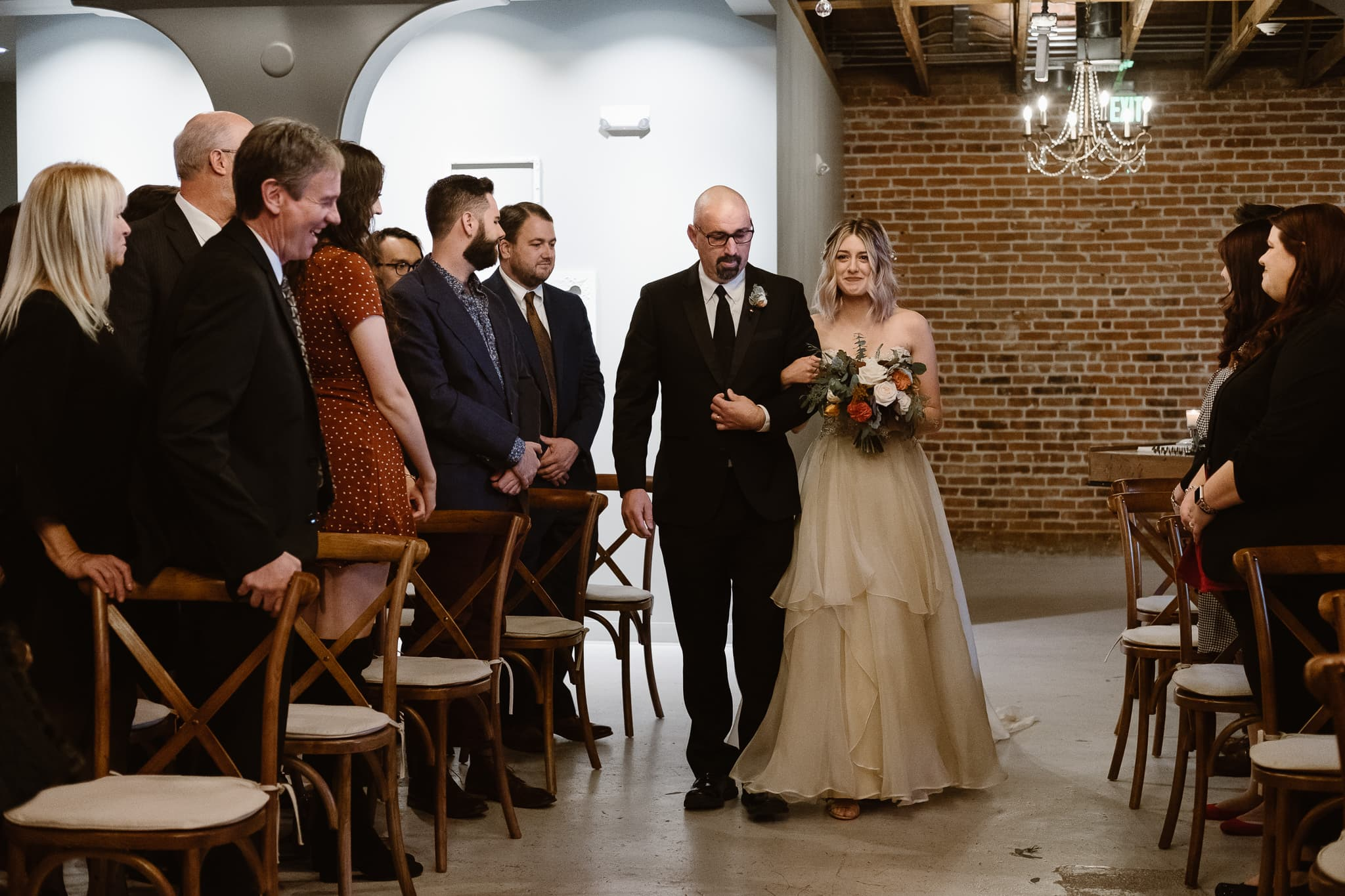 St Vrain Wedding Photographer | Longmont Wedding Photographer | Colorado Winter Wedding Photographer, Colorado industrial chic wedding ceremony, bride walking down aisle with her father