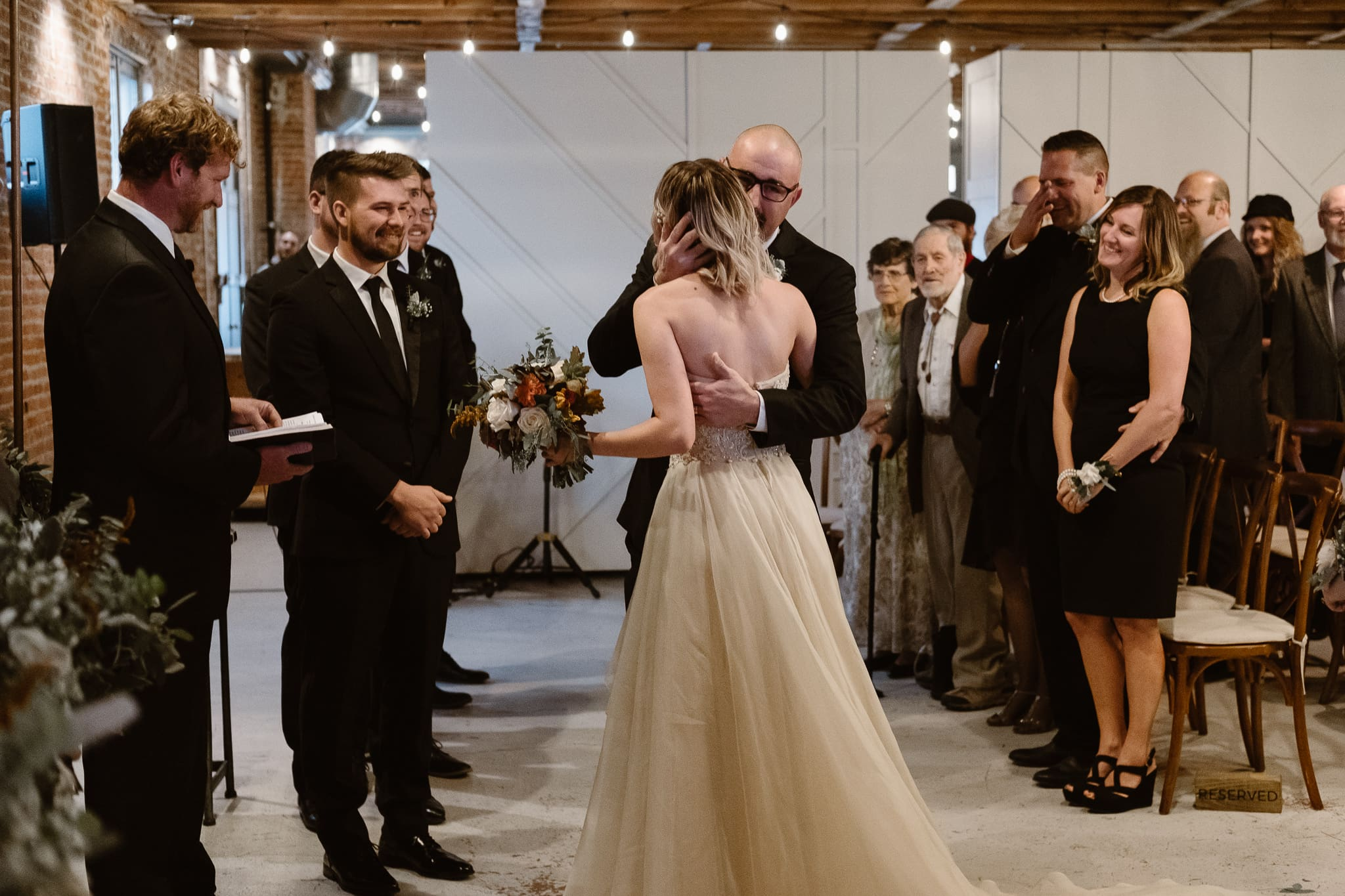 St Vrain Wedding Photographer   Longmont Wedding Photographer   Colorado Winter Wedding Photographer, Colorado industrial chic wedding ceremony, bride walking down aisle with her father