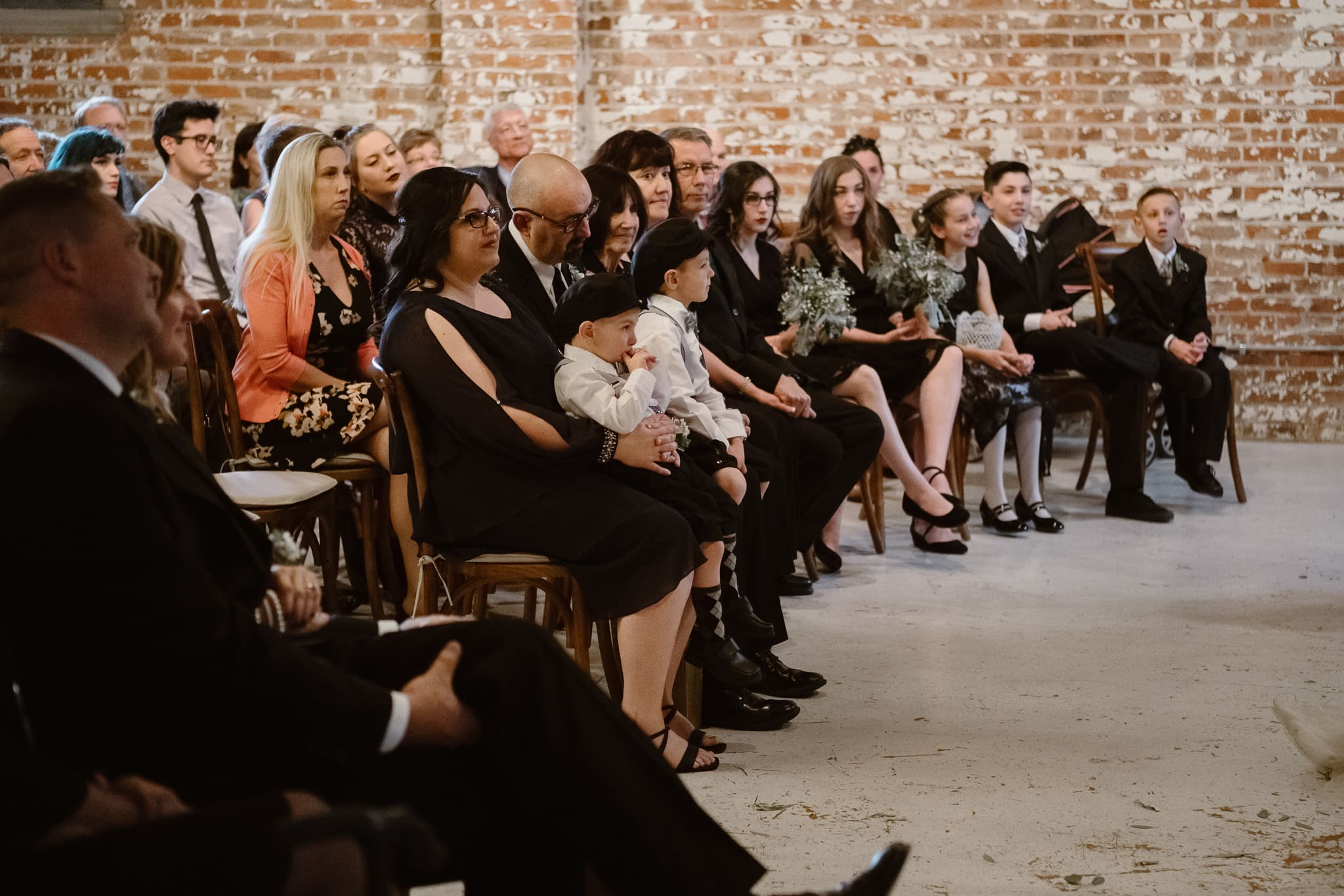 St Vrain Wedding Photographer | Longmont Wedding Photographer | Colorado Winter Wedding Photographer, Colorado industrial chic wedding ceremony, family watching ceremony