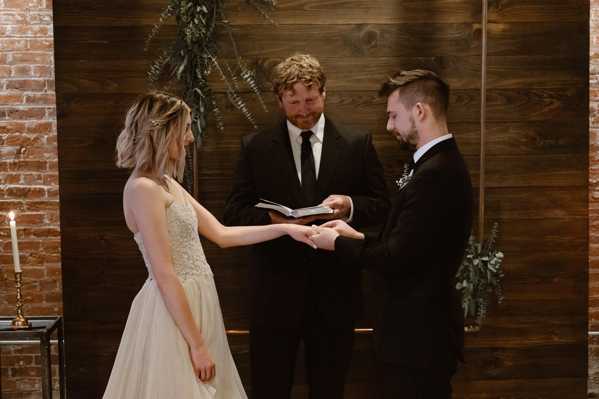 St Vrain Wedding Photographer | Longmont Wedding Photographer | Colorado Winter Wedding Photographer, Colorado industrial chic wedding ceremony, wedding ring exchange