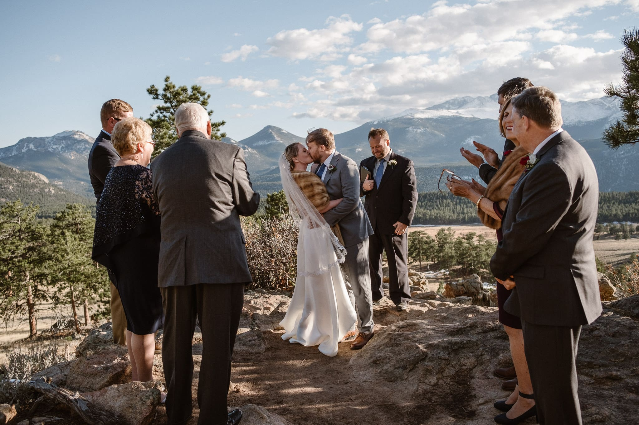 3M Curve Elopement Ceremony, Rocky Mountain National Park wedding photographer, Colorado mountain elopement, bride and groom first kiss, best month to elope in Colorado
