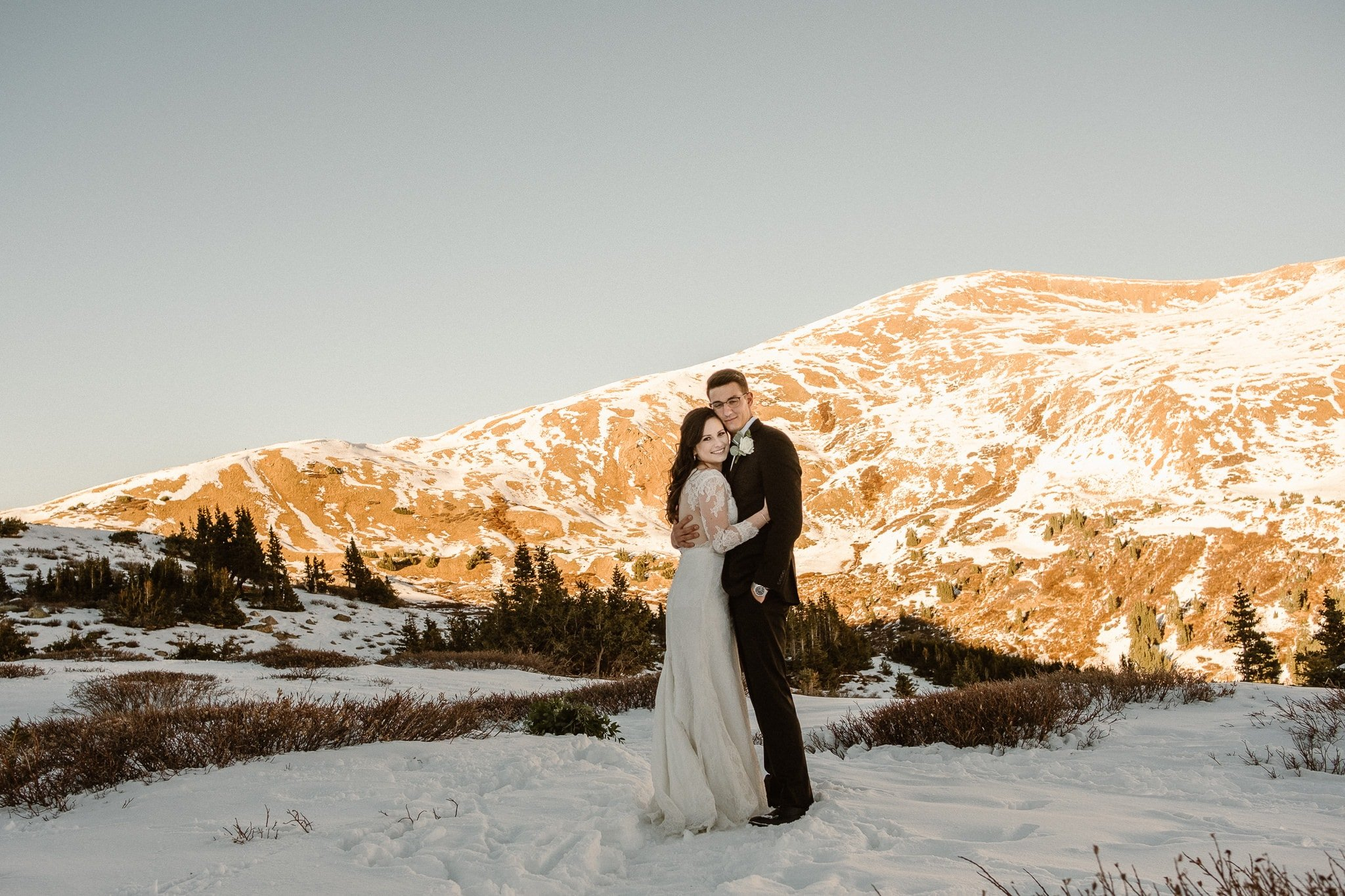 Colorado winter elopement photographer, Loveland Pass mountain elopement, adventure elopement photographer, bride and groom portraits in snow