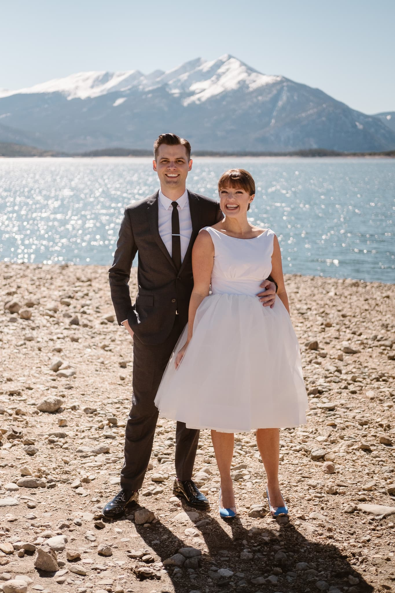 Bride and groom portraits at Lake Dillon in Summit County for Silverthorne Pavilion wedding, Colorado wedding photographer
