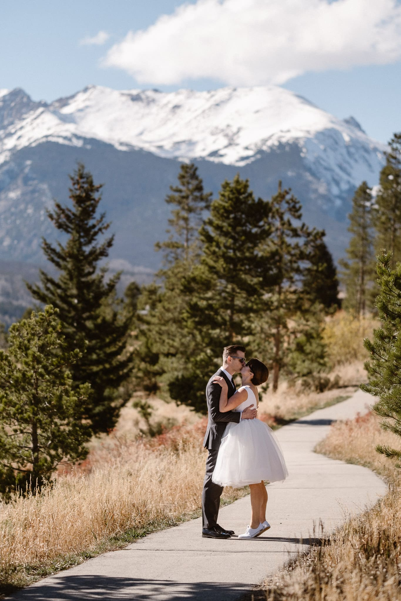 Bride and groom portraits at Lake Dillon in Summit County for Silverthorne Pavilion wedding, Colorado wedding photographer, mountain wedding, winter wedding