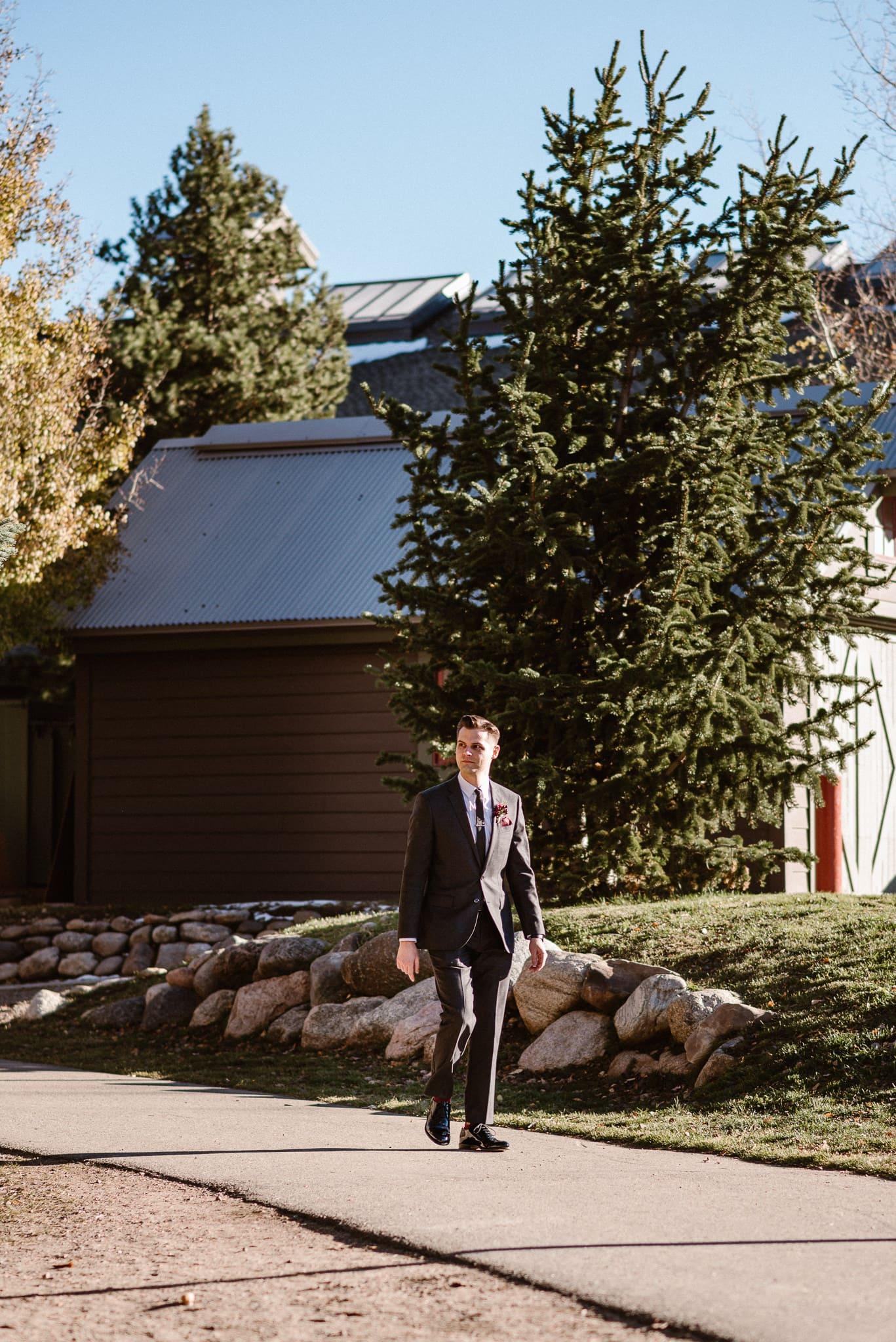 Silverthorne Pavilion wedding ceremony, Colorado wedding photographer, groom walking down ceremony aisle