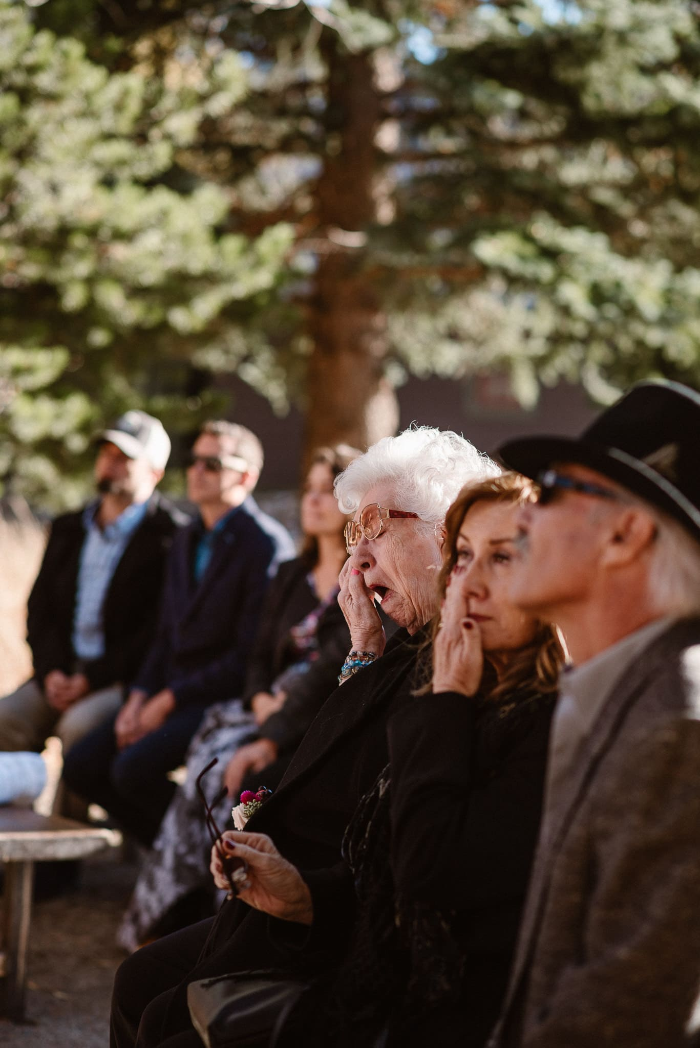 Silverthorne Pavilion wedding ceremony, Colorado wedding photographer, outdoor wedding ceremony, Colorado mountain wedding venues, family wiping tears