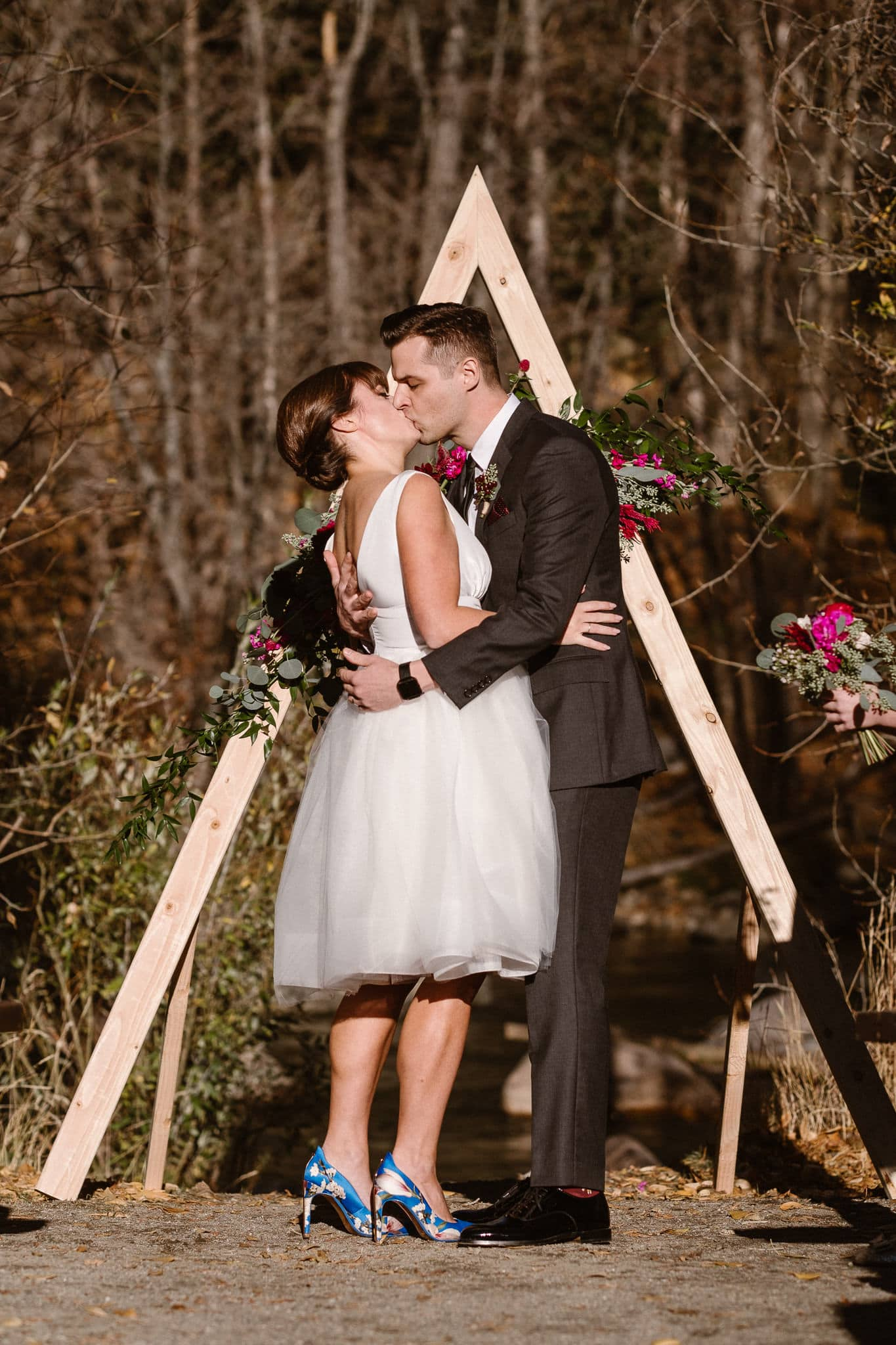 Silverthorne Pavilion wedding ceremony, Colorado wedding photographer, outdoor wedding ceremony, Colorado mountain wedding venues, bride and groom first kiss