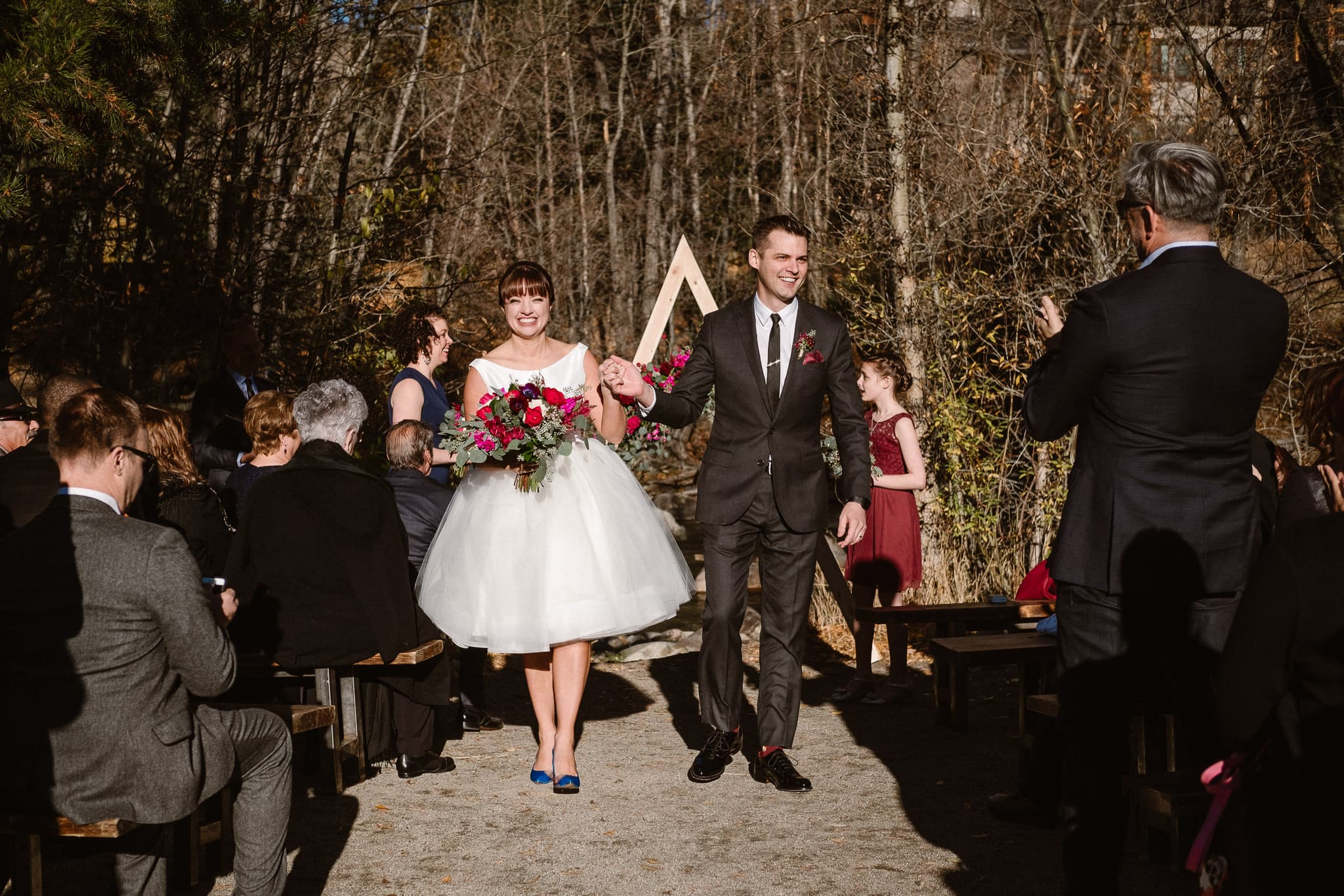 Silverthorne Pavilion wedding ceremony, Colorado wedding photographer, outdoor wedding ceremony, Colorado mountain wedding venues, bride and groom recessional