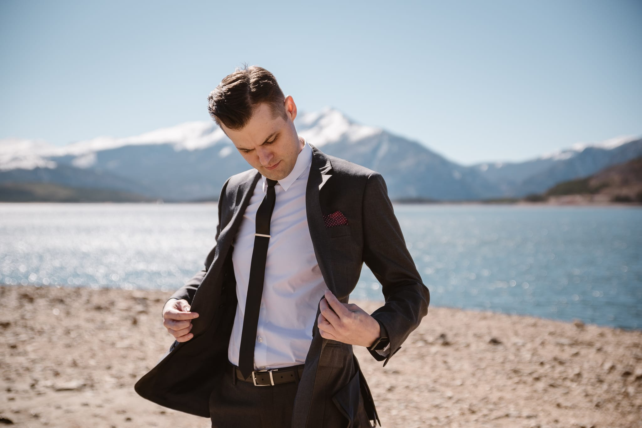 Groom portraits at Lake Dillon in Summit County for Silverthorne Pavilion wedding, Colorado wedding photographer