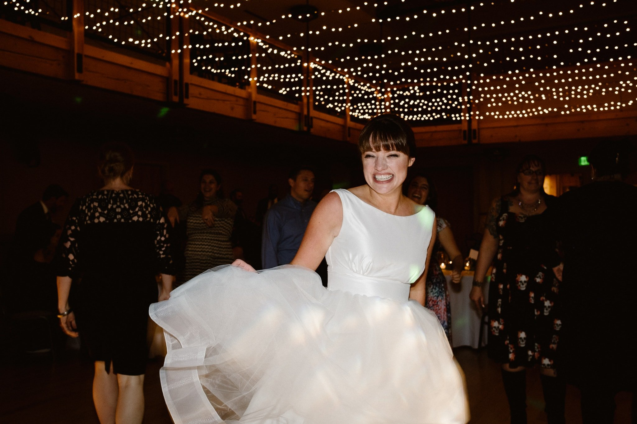Silverthorne Pavilion wedding photography, Colorado wedding photographer, wedding reception dance party, bride dancing