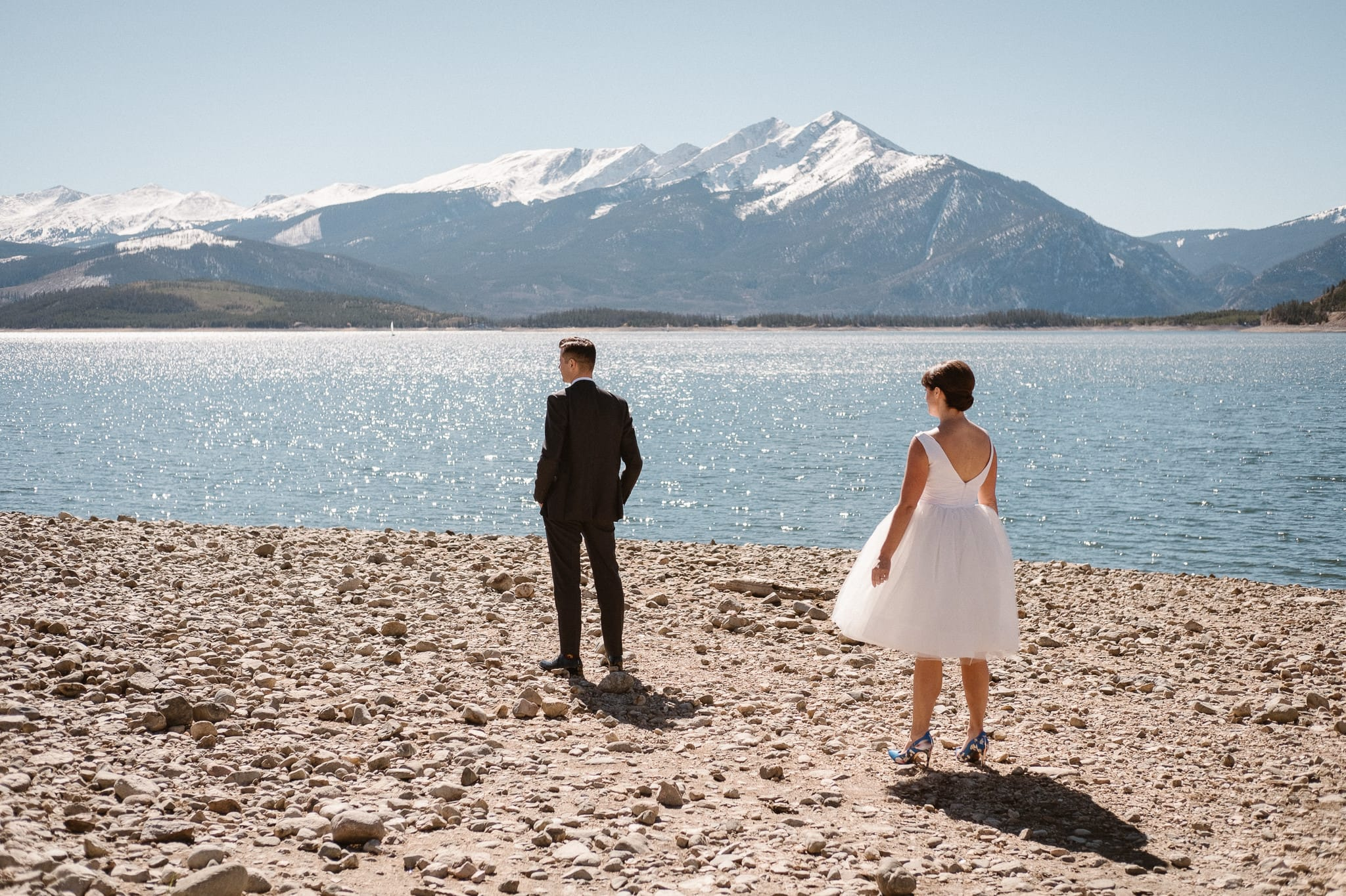 Bride and groom first look at Lake Dillon in Summit County for Silverthorne Pavilion wedding, Colorado wedding photographer