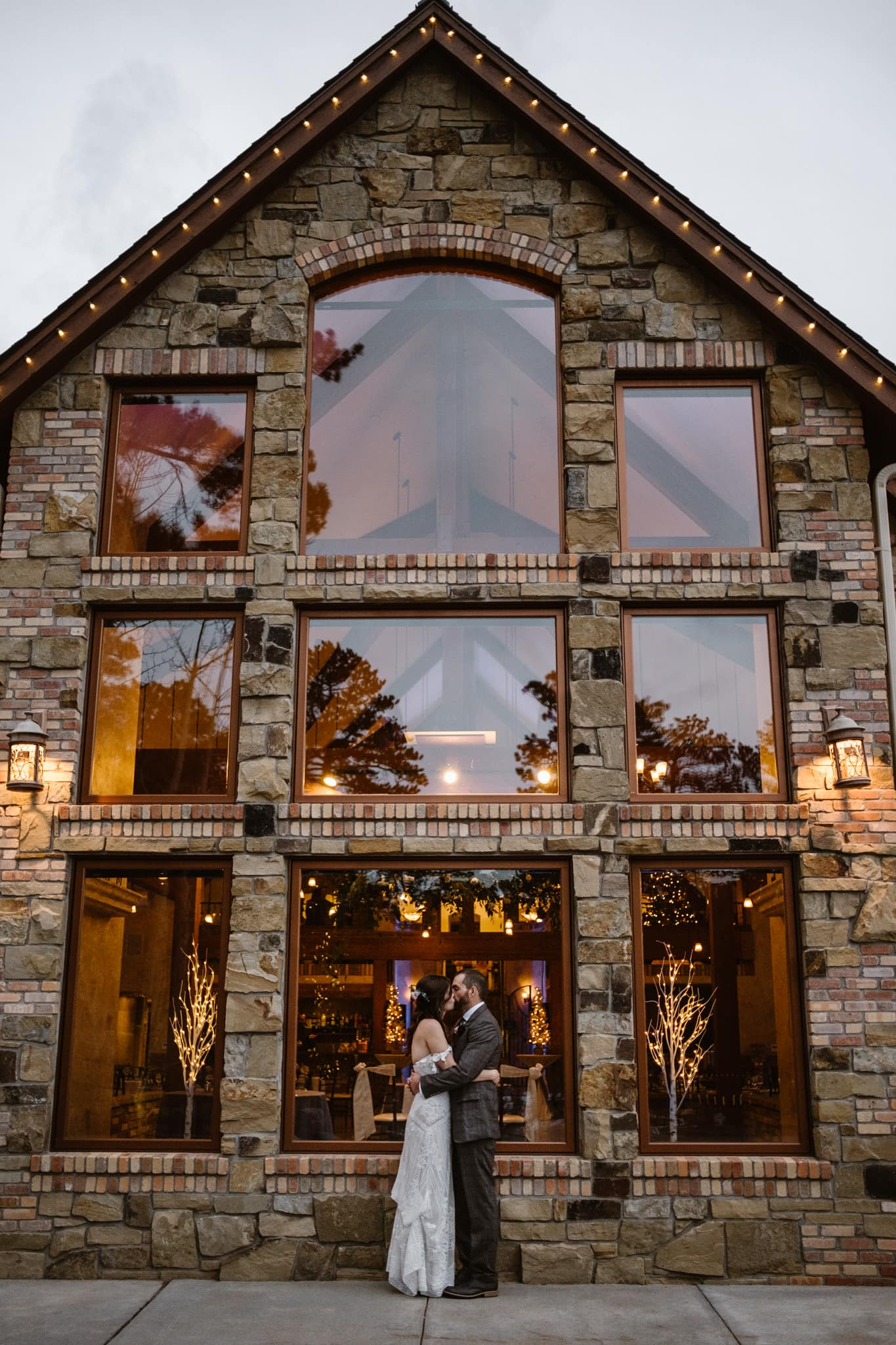 Bride and groom portrait at Della Terra Mountain Chateau wedding in winter, Estes Park wedding photographer, bride wearing Rue de Seine Fox gown