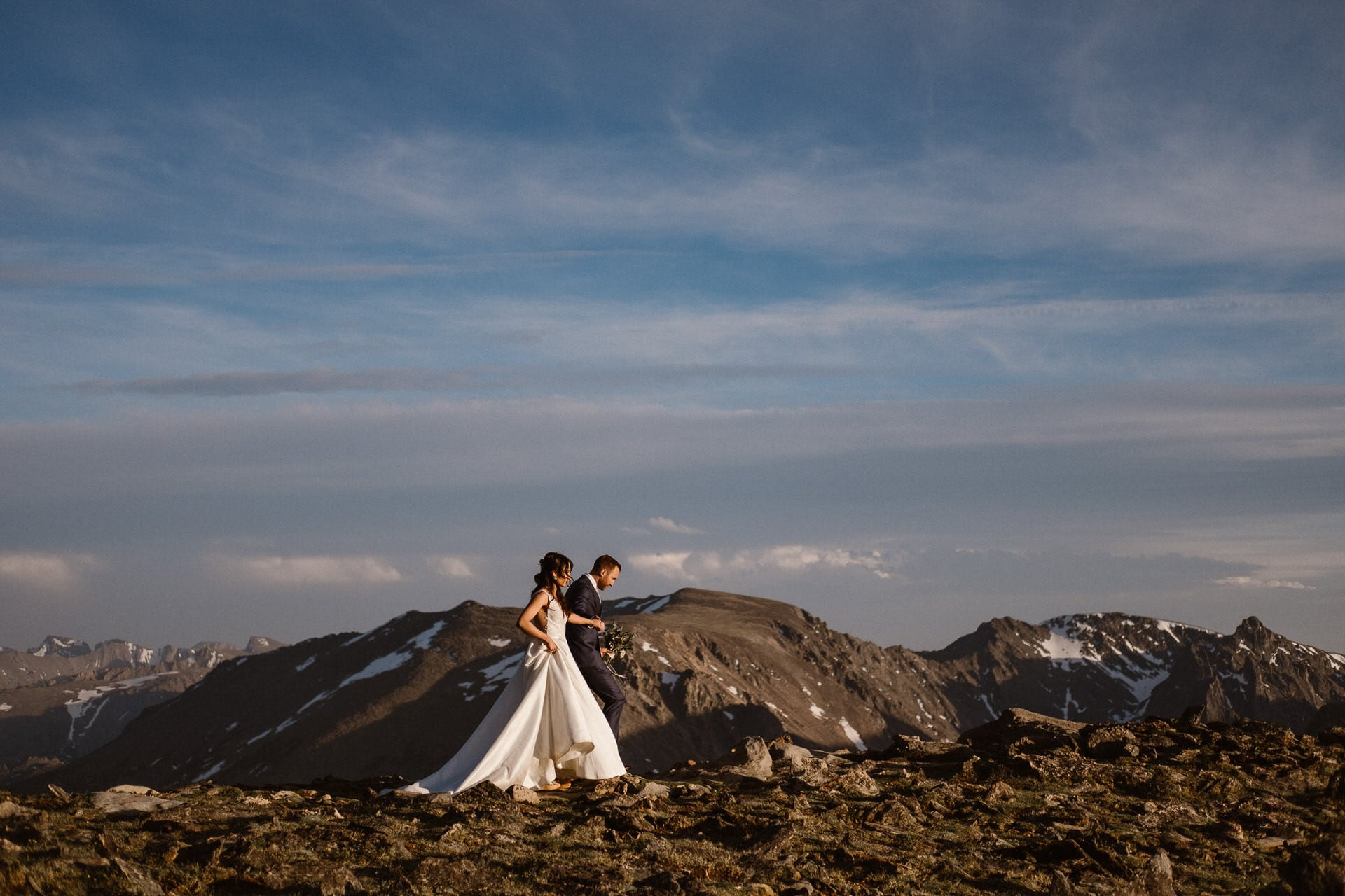 Bride and groom in the Rocky Mountains.