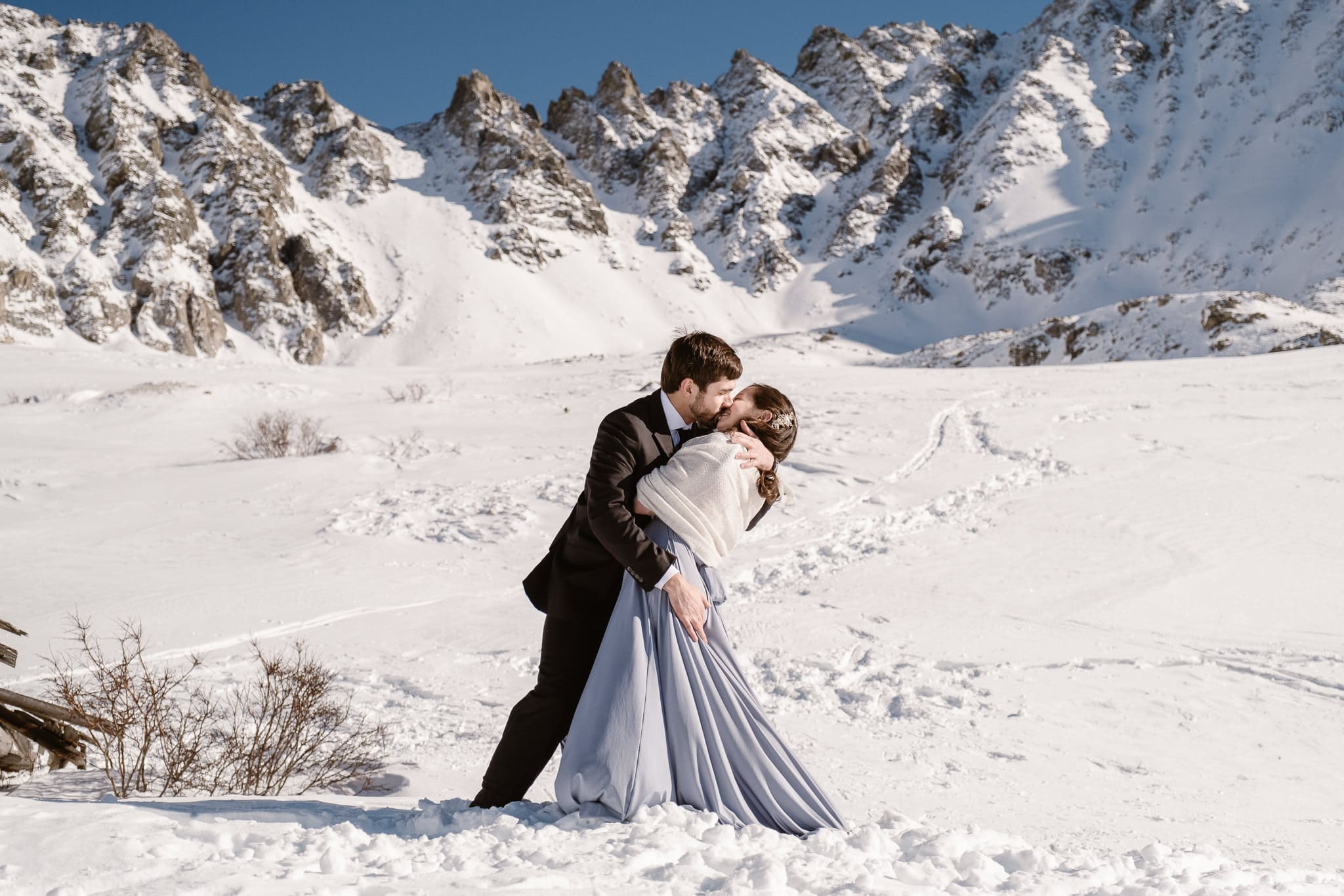 Bride and groom first kiss, winter mountain elopement, Colorado snow elopement, winter wedding