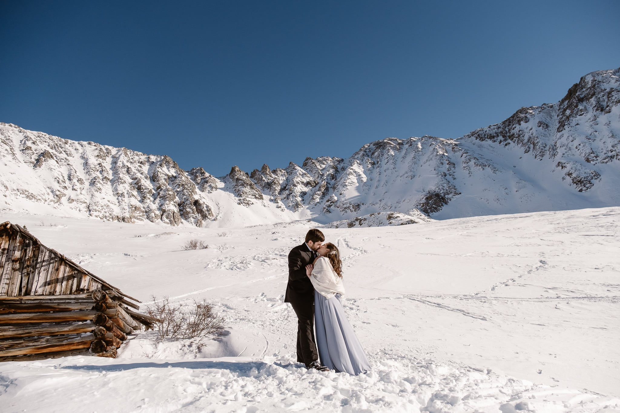 Bride and groom kissing, winter mountain elopement, Colorado ski wedding, backcountry skiing elopement
