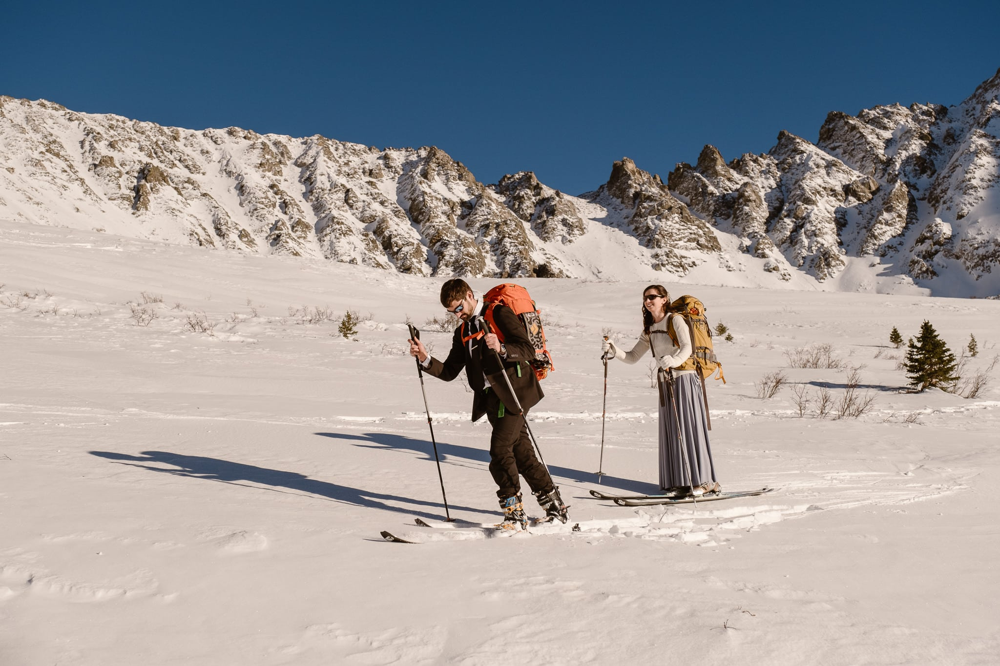 Bride and groom skinning up Colorado mountains, backcountry skiing elopement near Leadville, Mayflower Gulch elopement