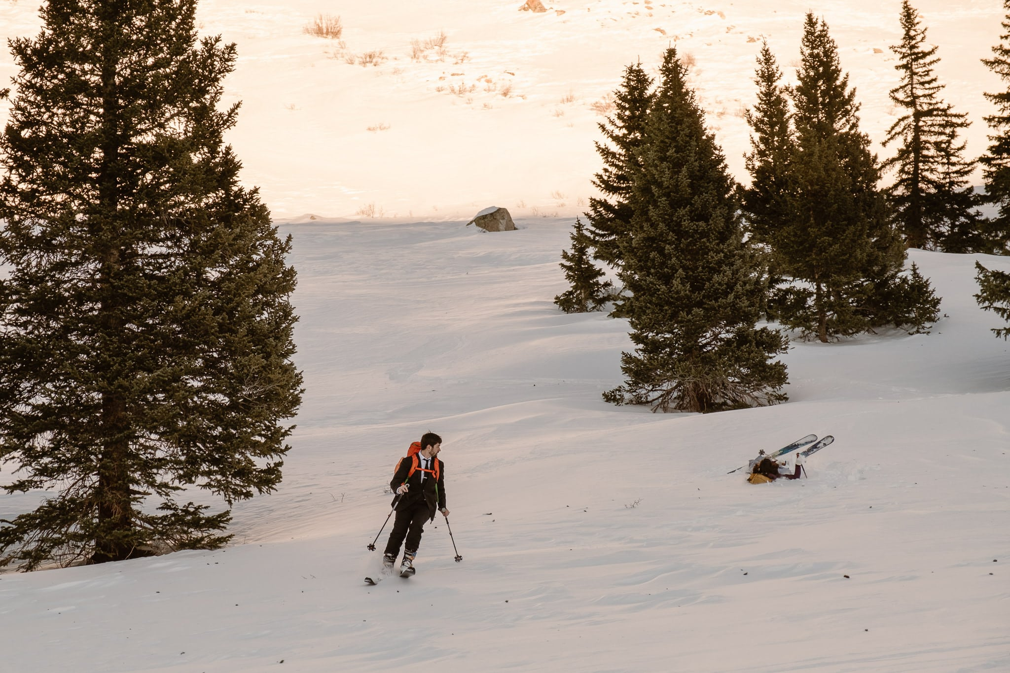 Bride and groom skiing in Colorado mountains, backcountry skiing elopement near Leadville, Mayflower Gulch elopement