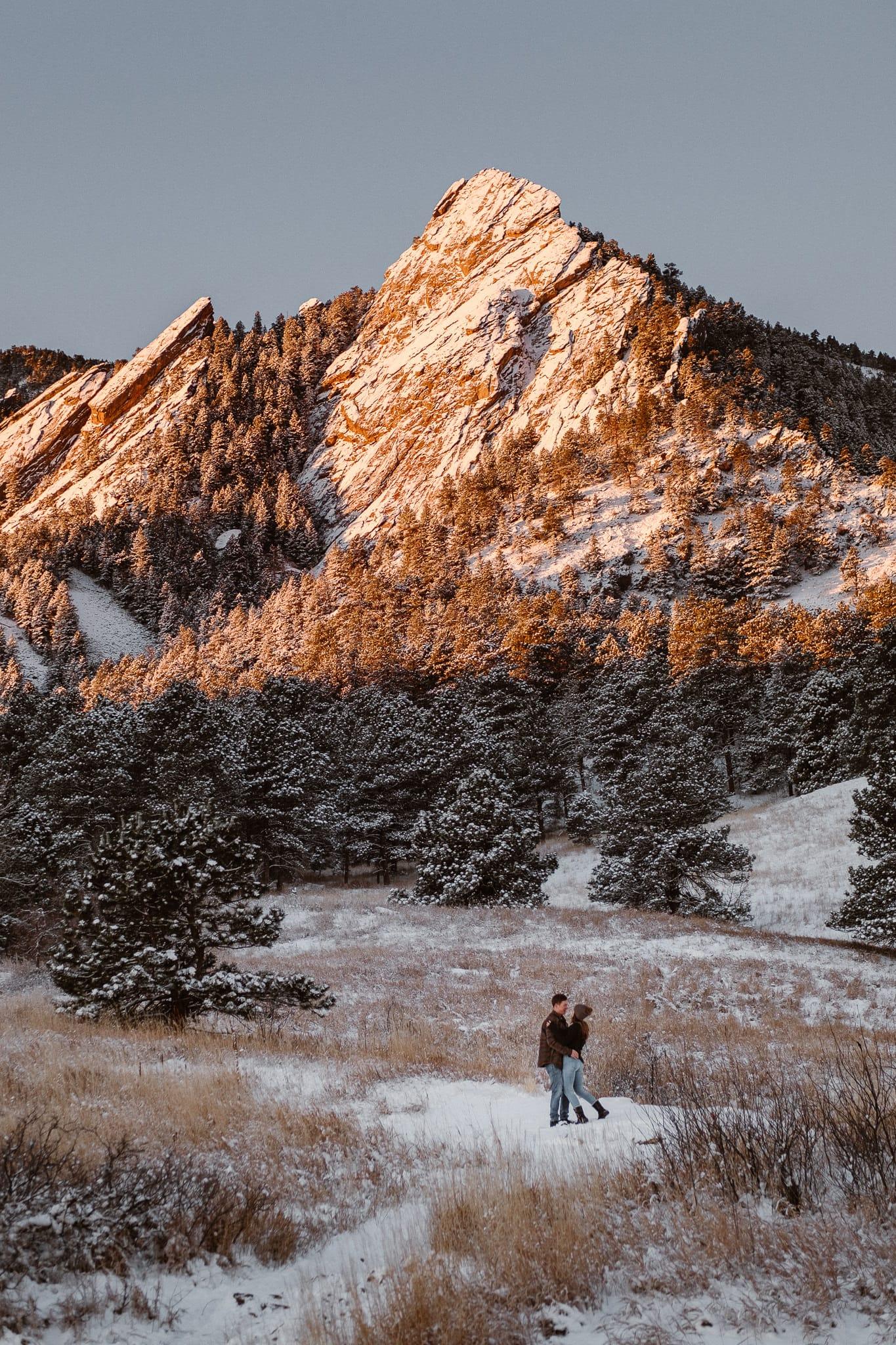 Couple hiking mountains at sunrise, Chautauqua winter engagement photography session, Boulder engagement photographer, sunrise hiking engagement session, Colorado wedding photographer