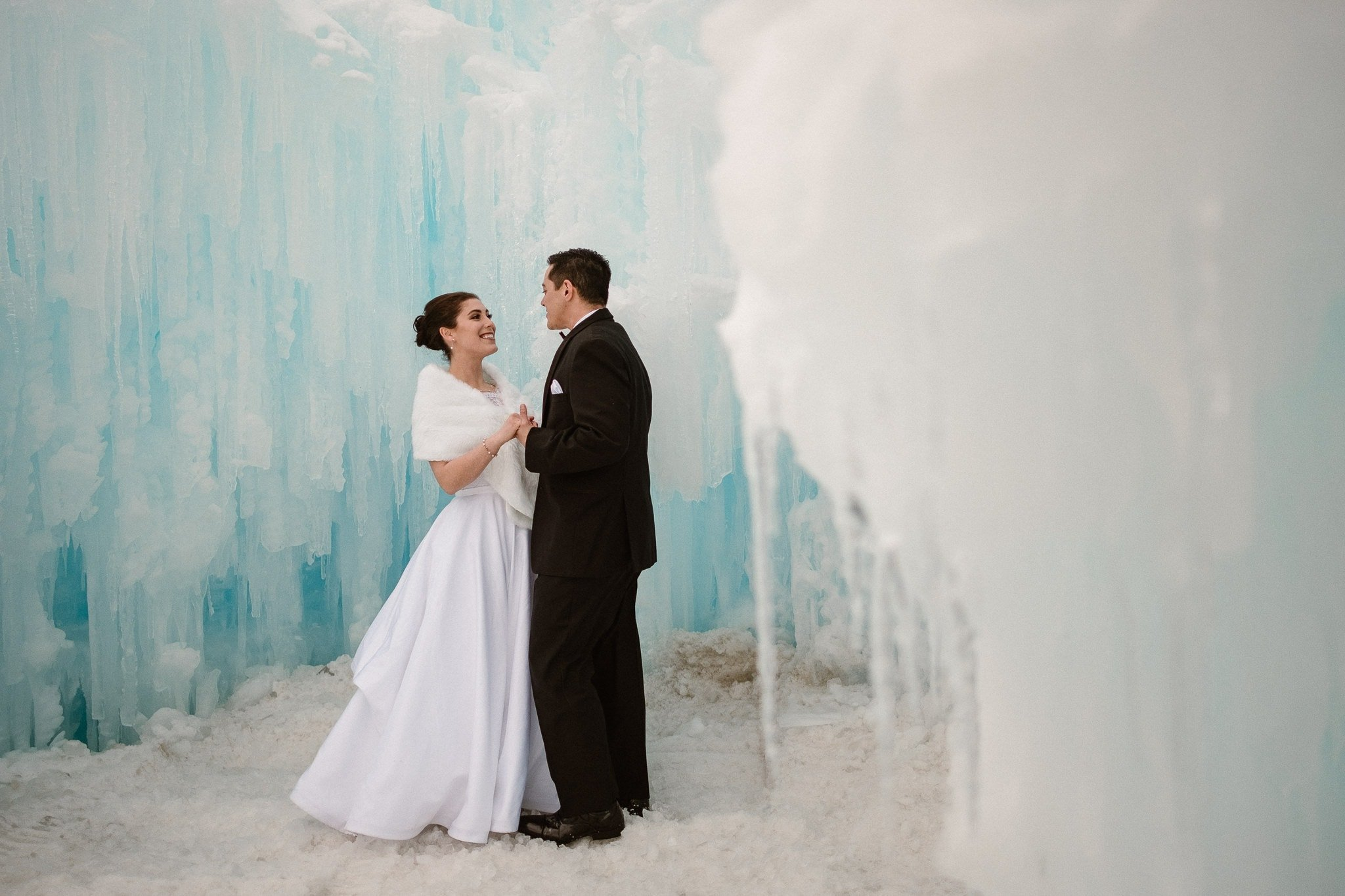 Ice Castles wedding photography, Dillon Colorado winter elopement, bride and groom inside ice castle