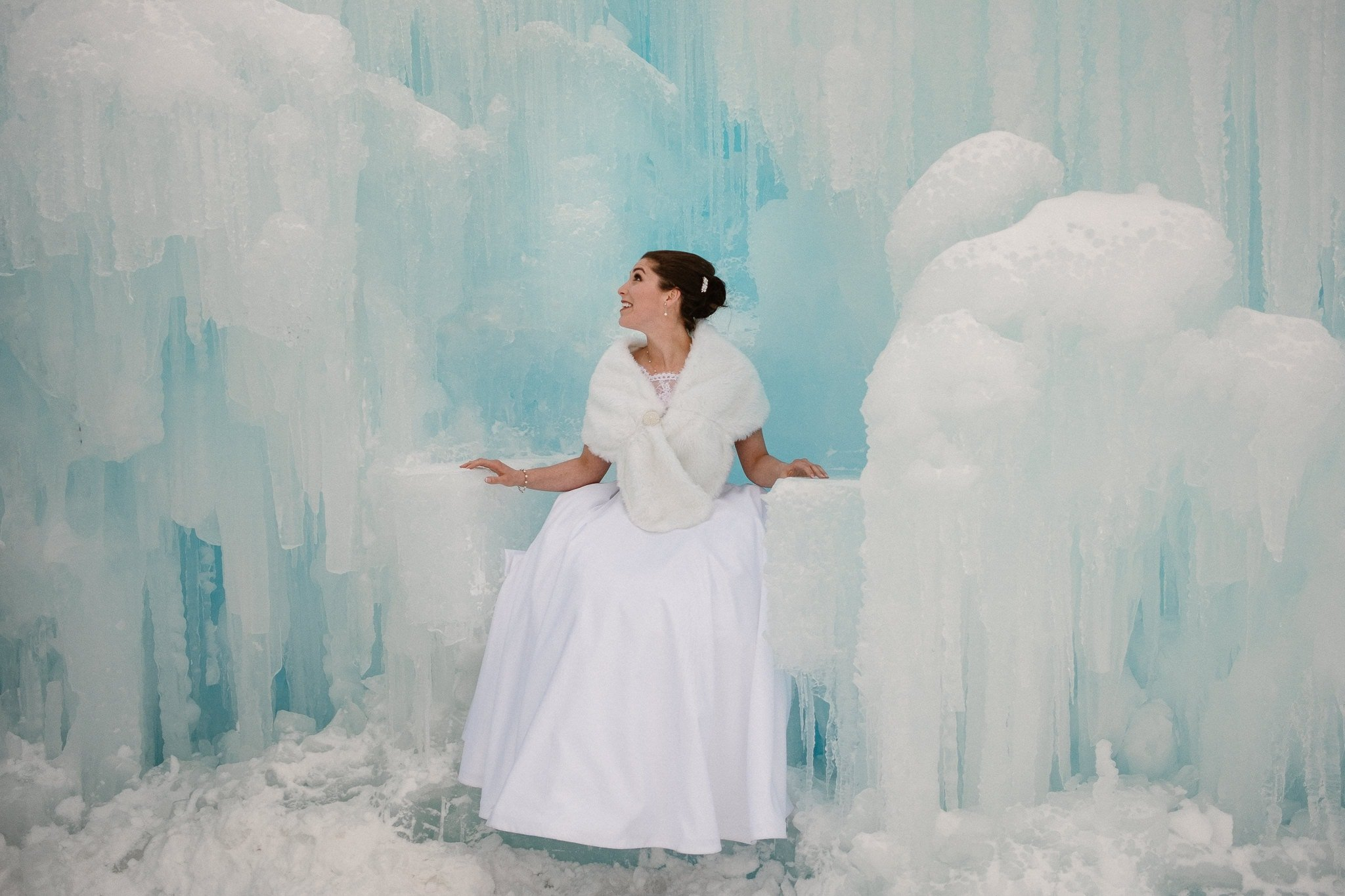 Ice Castles wedding photography, Dillon Colorado winter elopement, bride inside ice castle