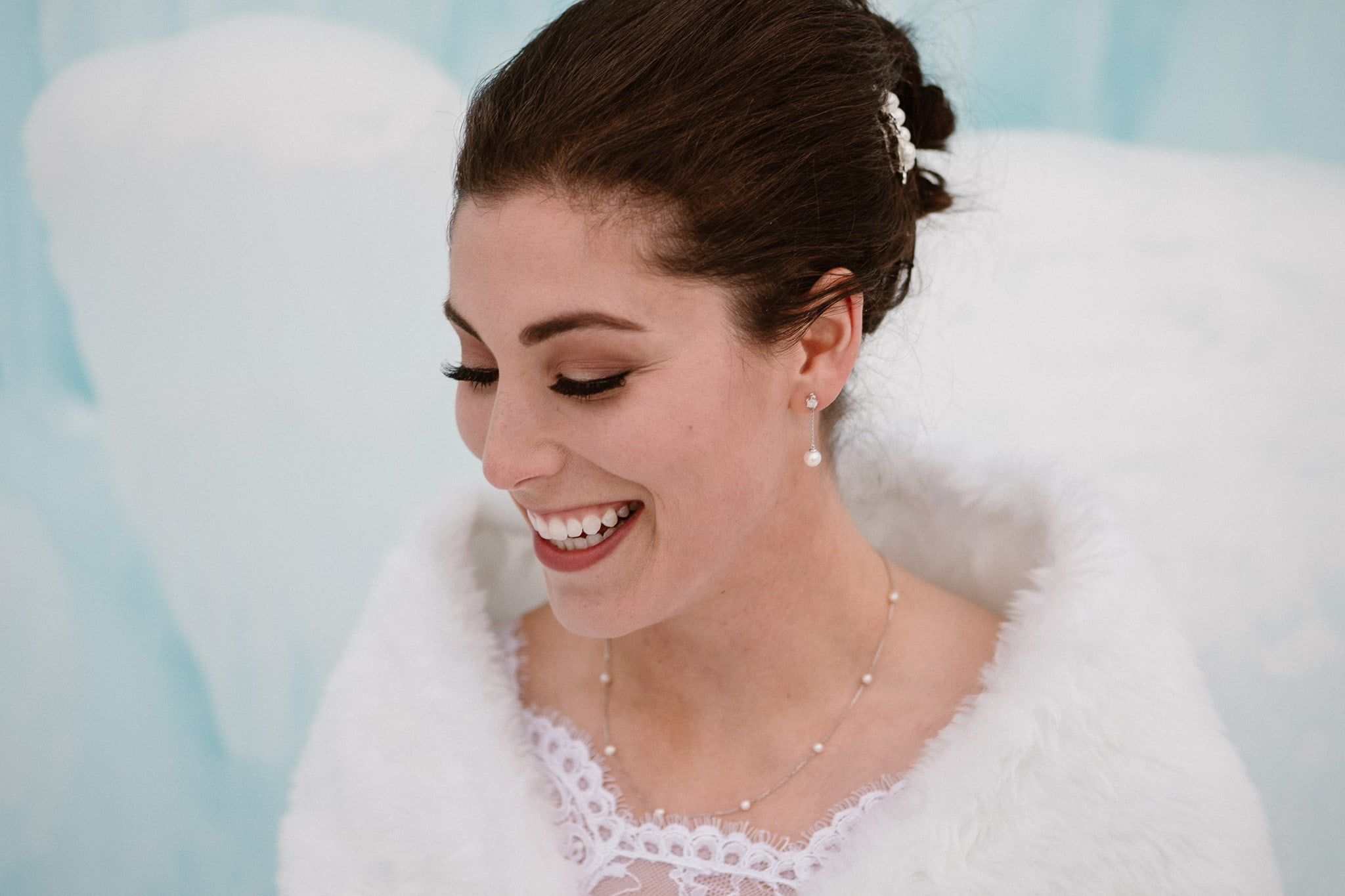 Ice Castles wedding photography, Dillon Colorado winter elopement, closeup of bride inside ice castle