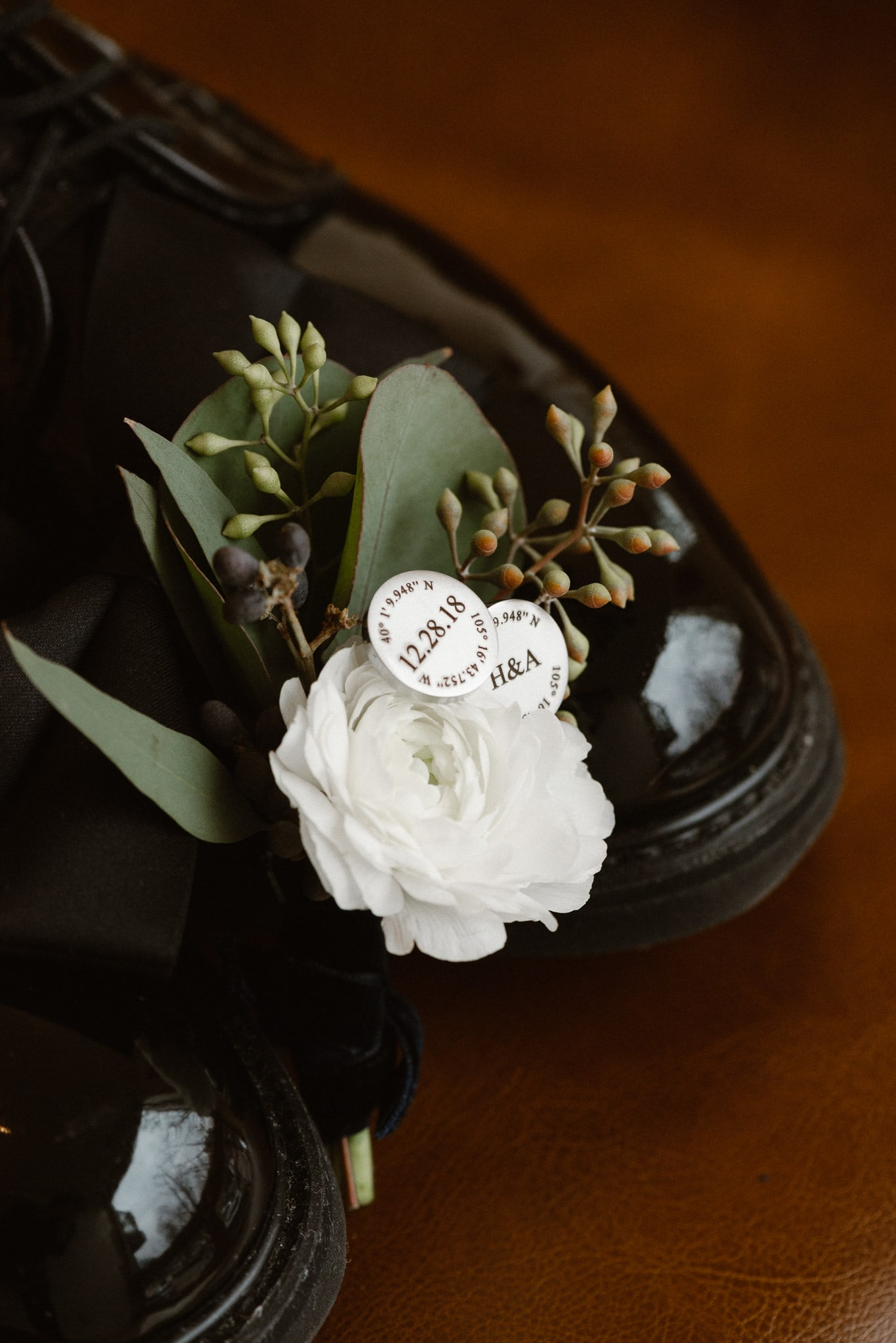Rembrandt Yard wedding photographer, Boulder wedding photographer, Colorado Jewish wedding, groom's cufflinks with wedding date and coordinates plus shoes and boutonniere
